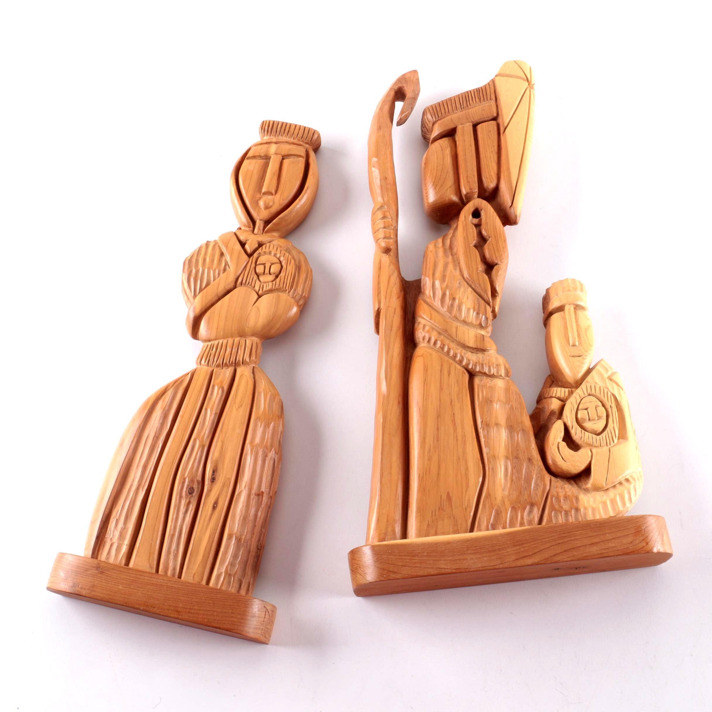 Pair of Dan Rael Carved Wooden Figures
