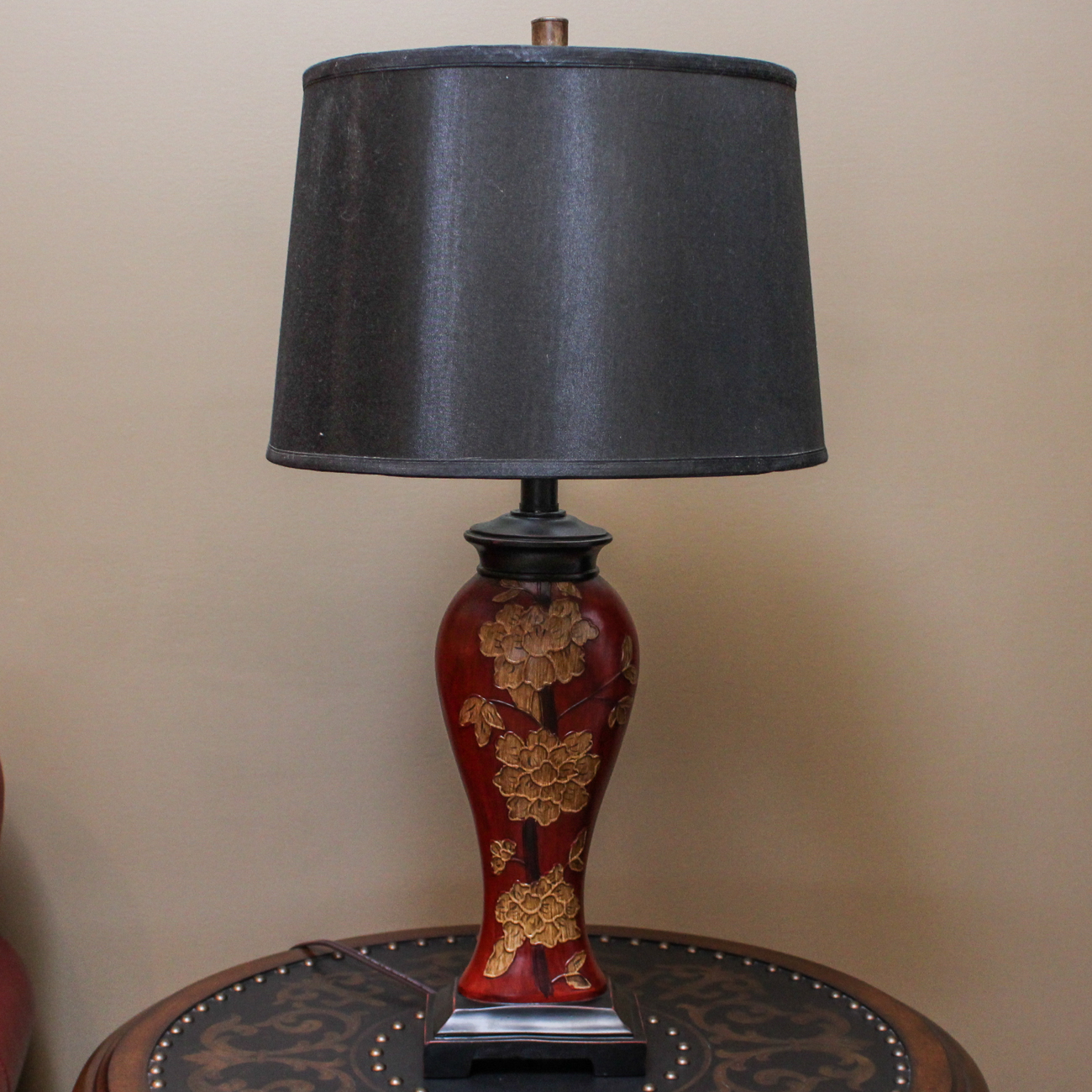 Asian style table lamp with embossed floral motif
