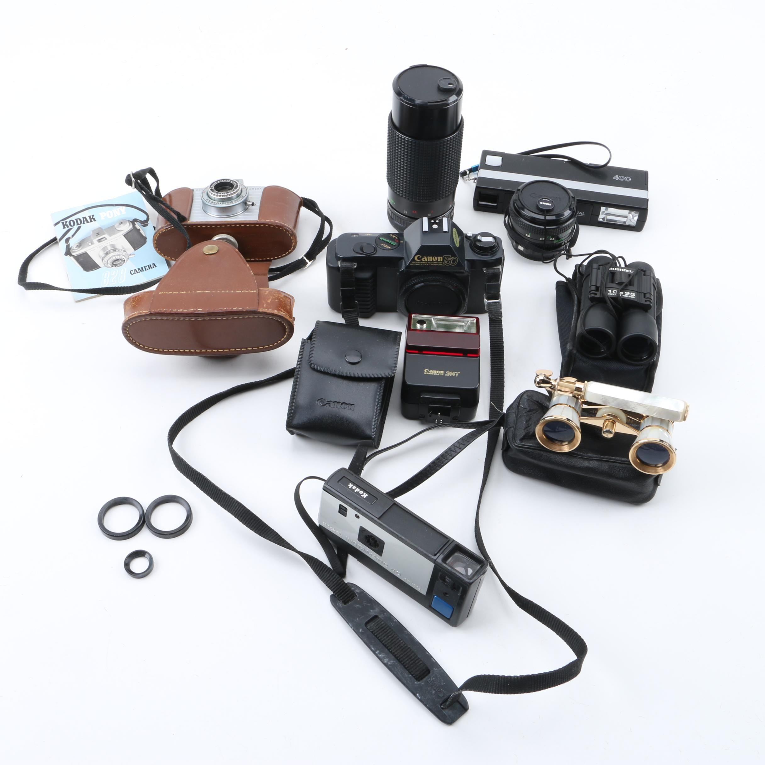 Vintage Kodak and Canon Cameras with Binoculars and Accessories