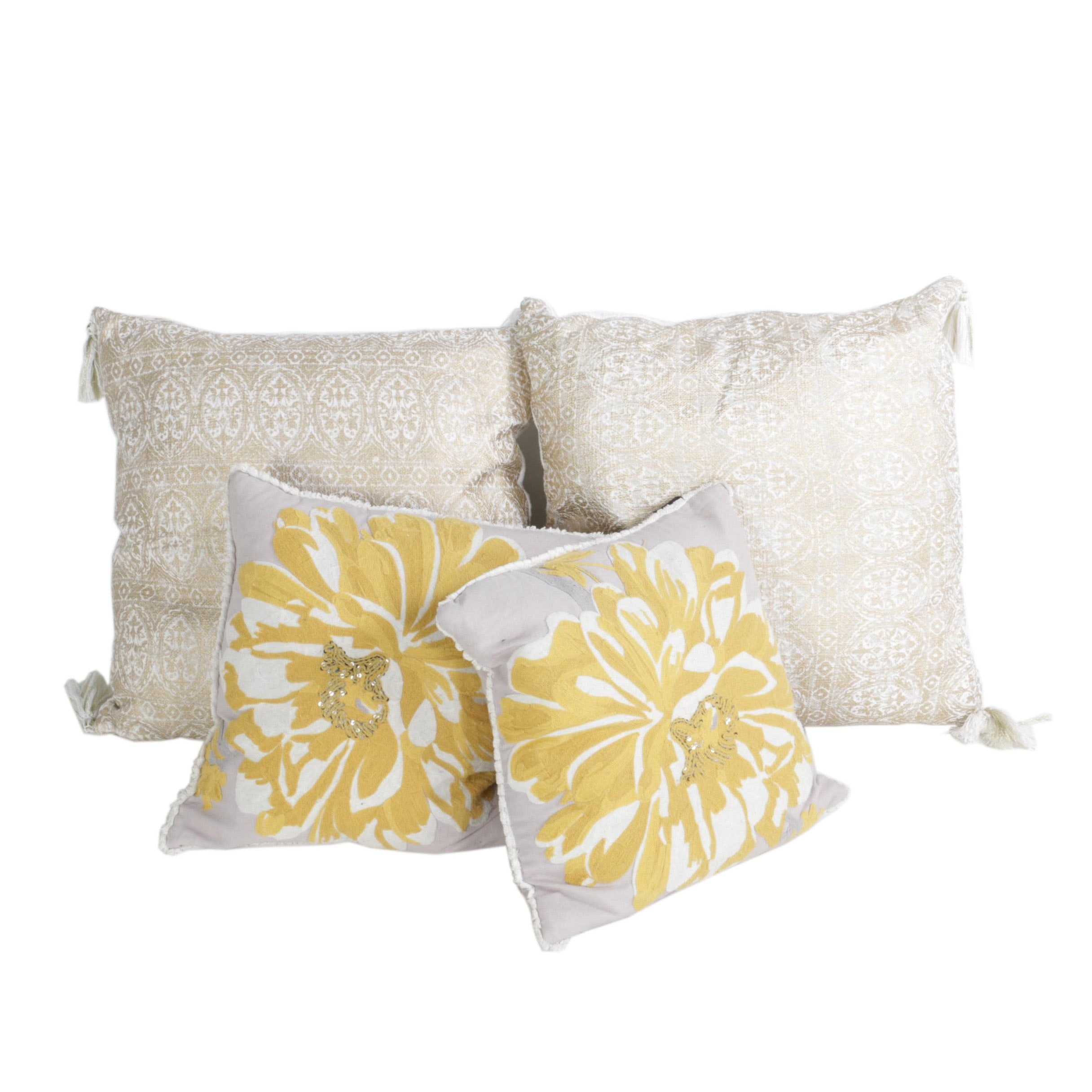 Pairs of Decorative Pillows with Floral Motifs and Tassel Accents