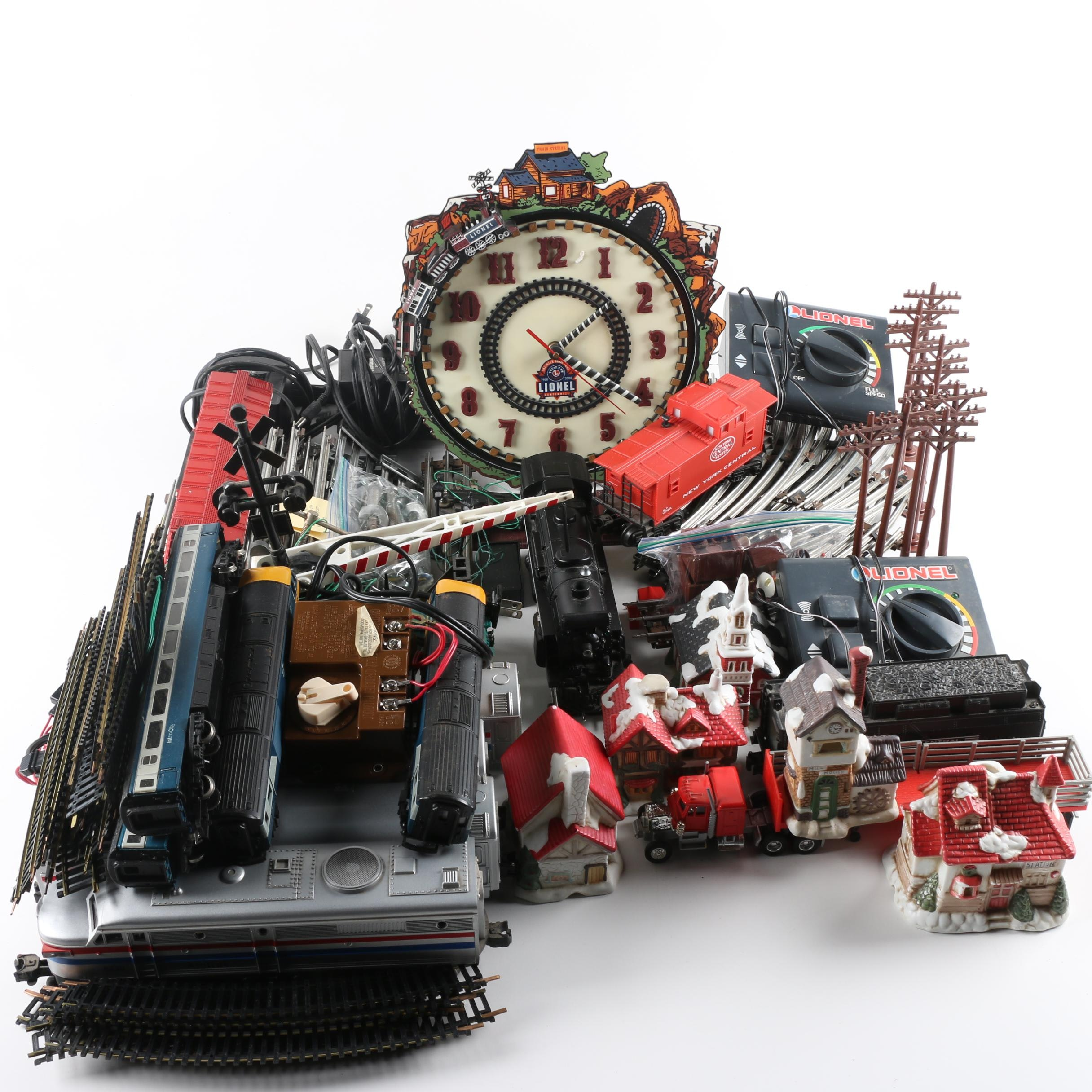 Lionel Trains, Accessories, and Clock with Christmas Village Decor