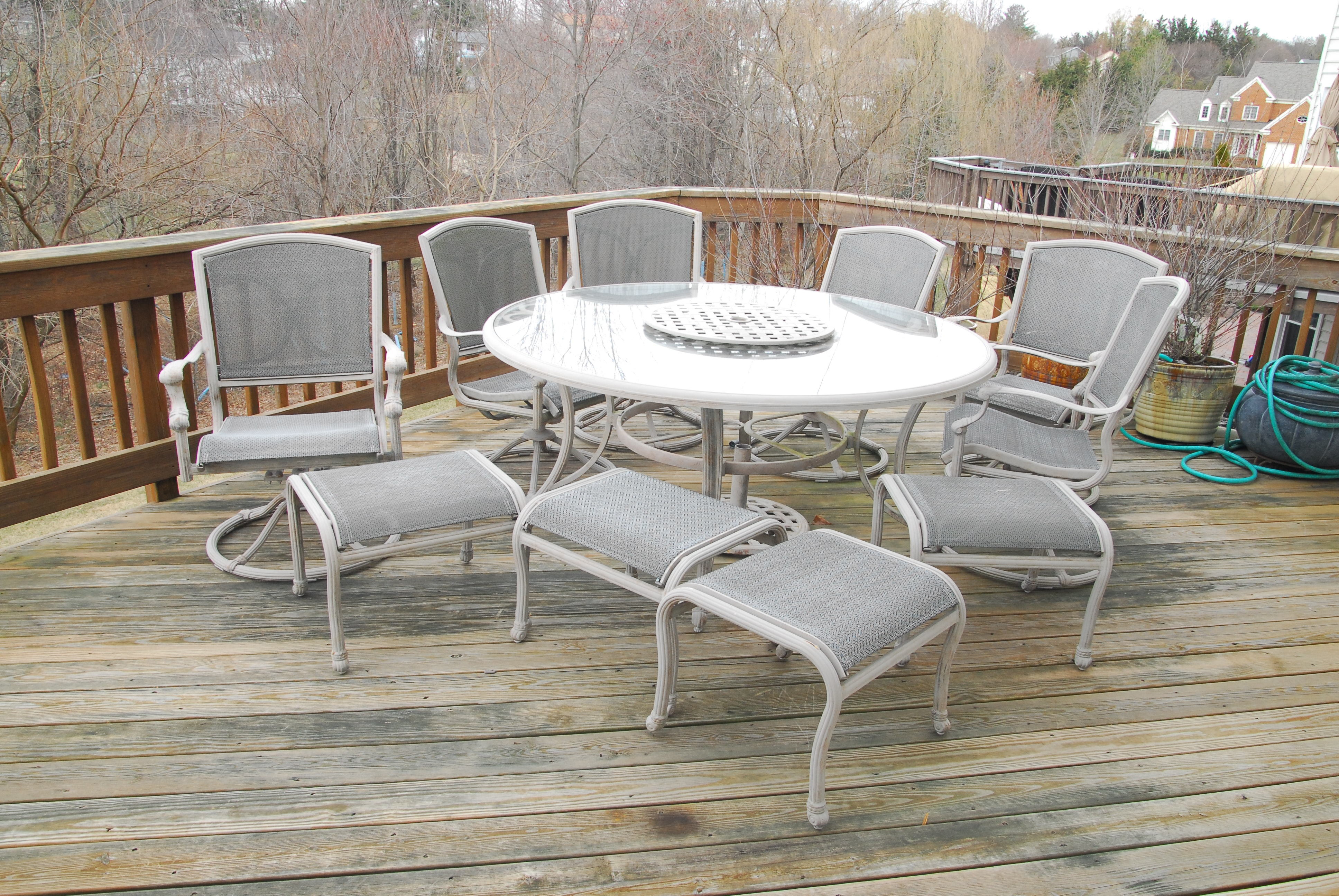 Glass Top Patio Table with Chairs and Ottomans