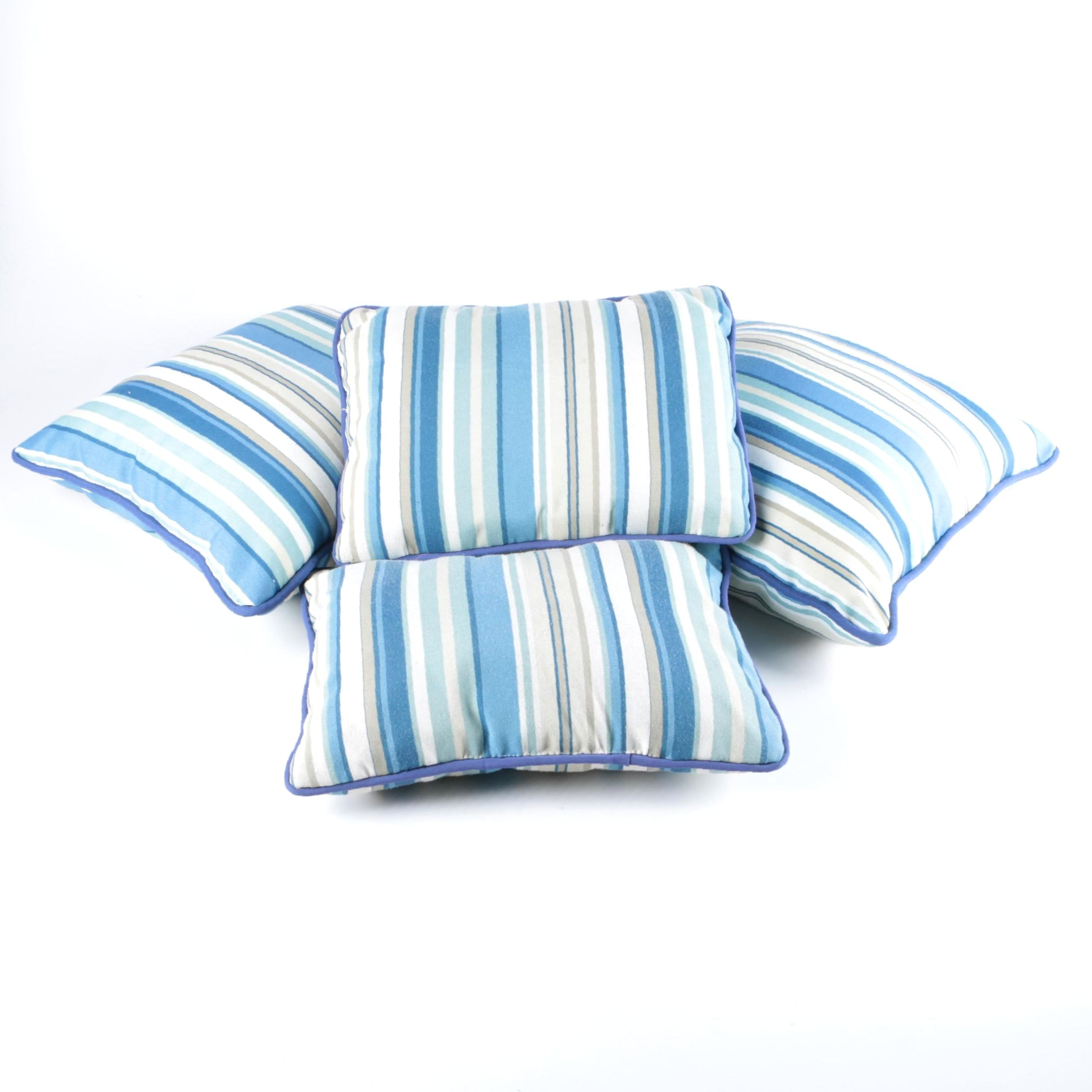 Four Blue and White Striped Accent Pillows