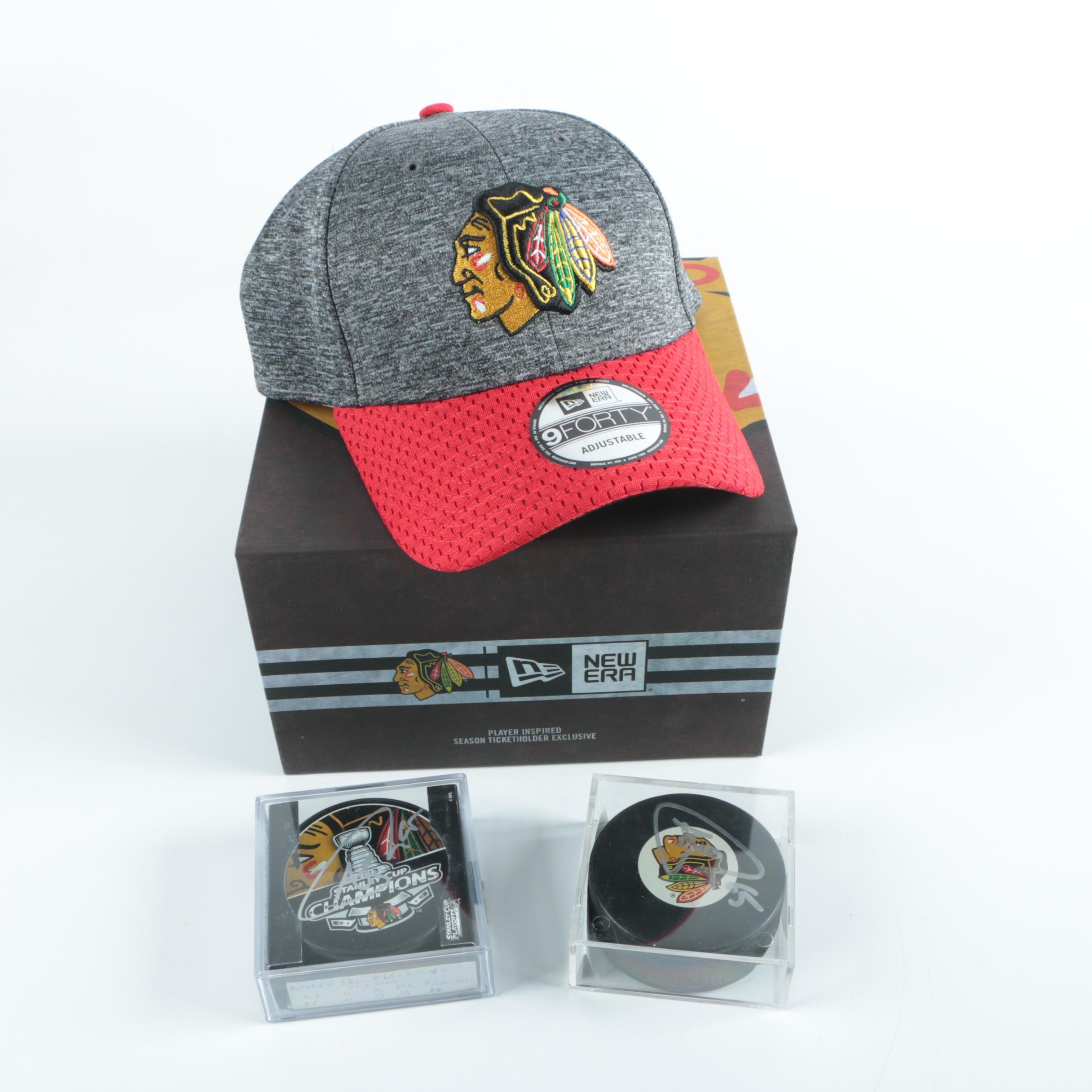 Autographed Andrew Shaw Chicago Blackhawks Pucks with Blackhawks Hat