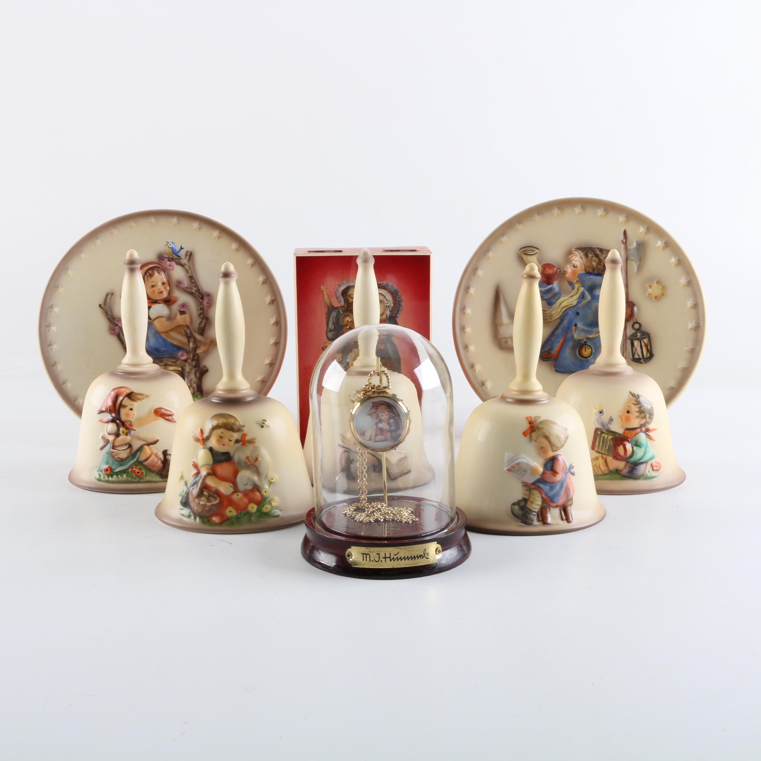 Collection of Hummel Plates, Bells, Music Box, and Hanging Watch in Glass Case
