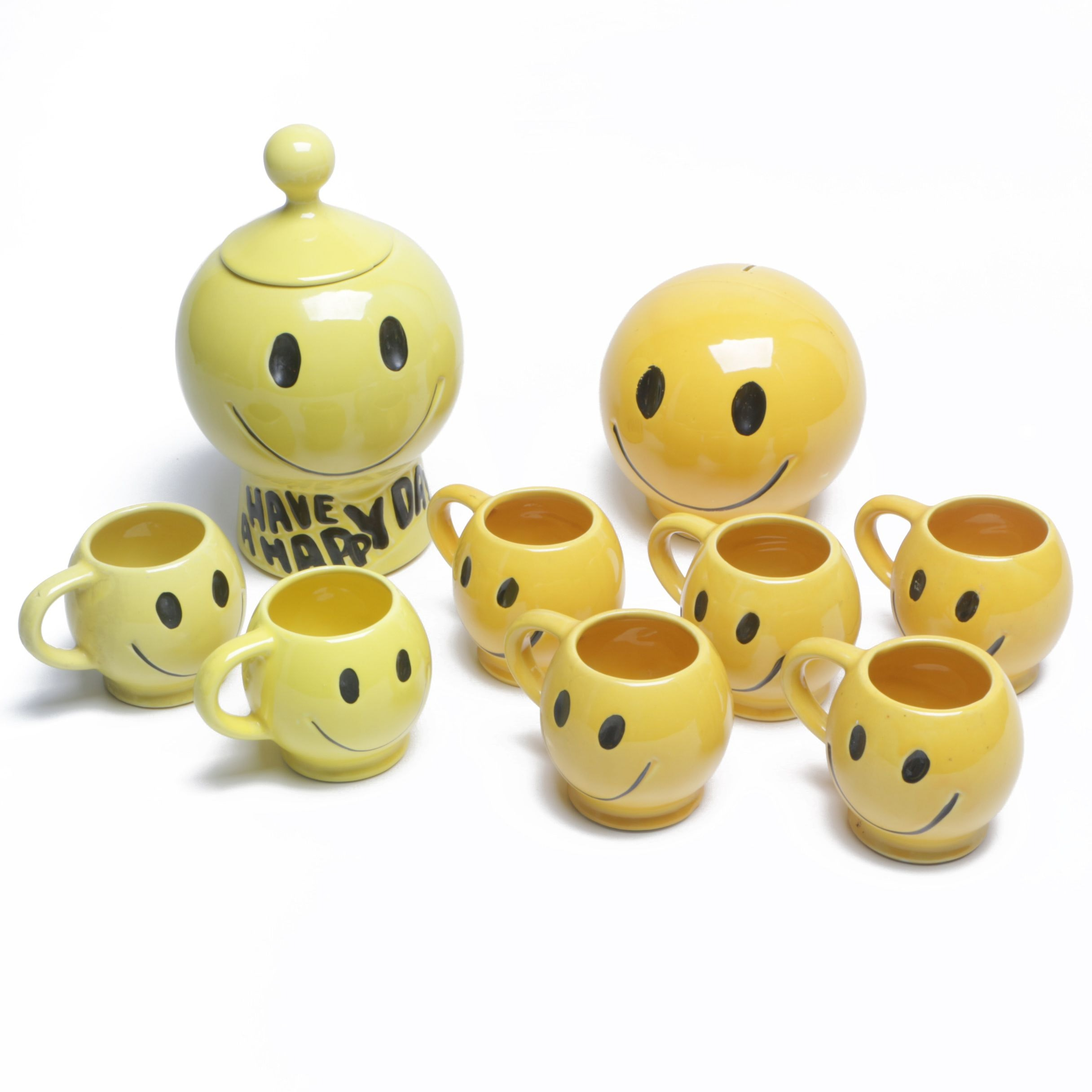 "1970s McCoy Pottery ""Have a Happy Day"" Smiley Face Mugs, Cookie Jar, and Bank"