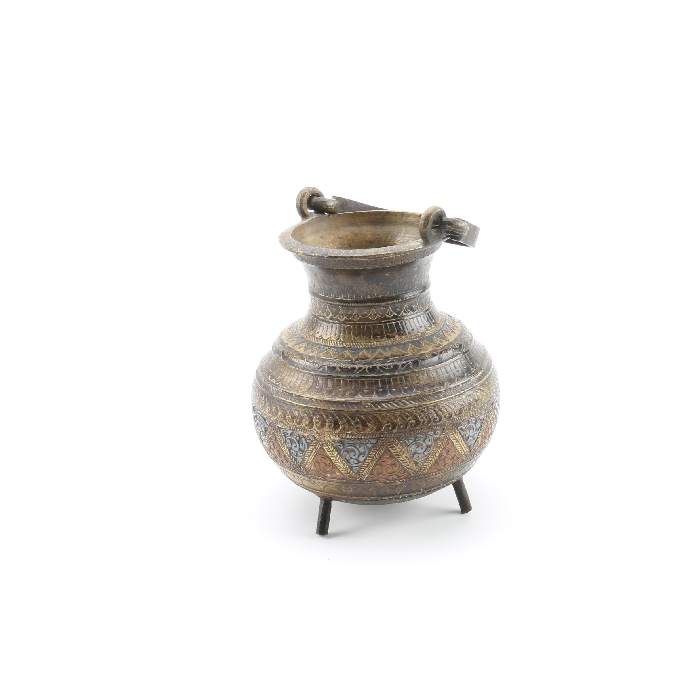 Footed Brass Vase Featuring Incised Geometric Designs