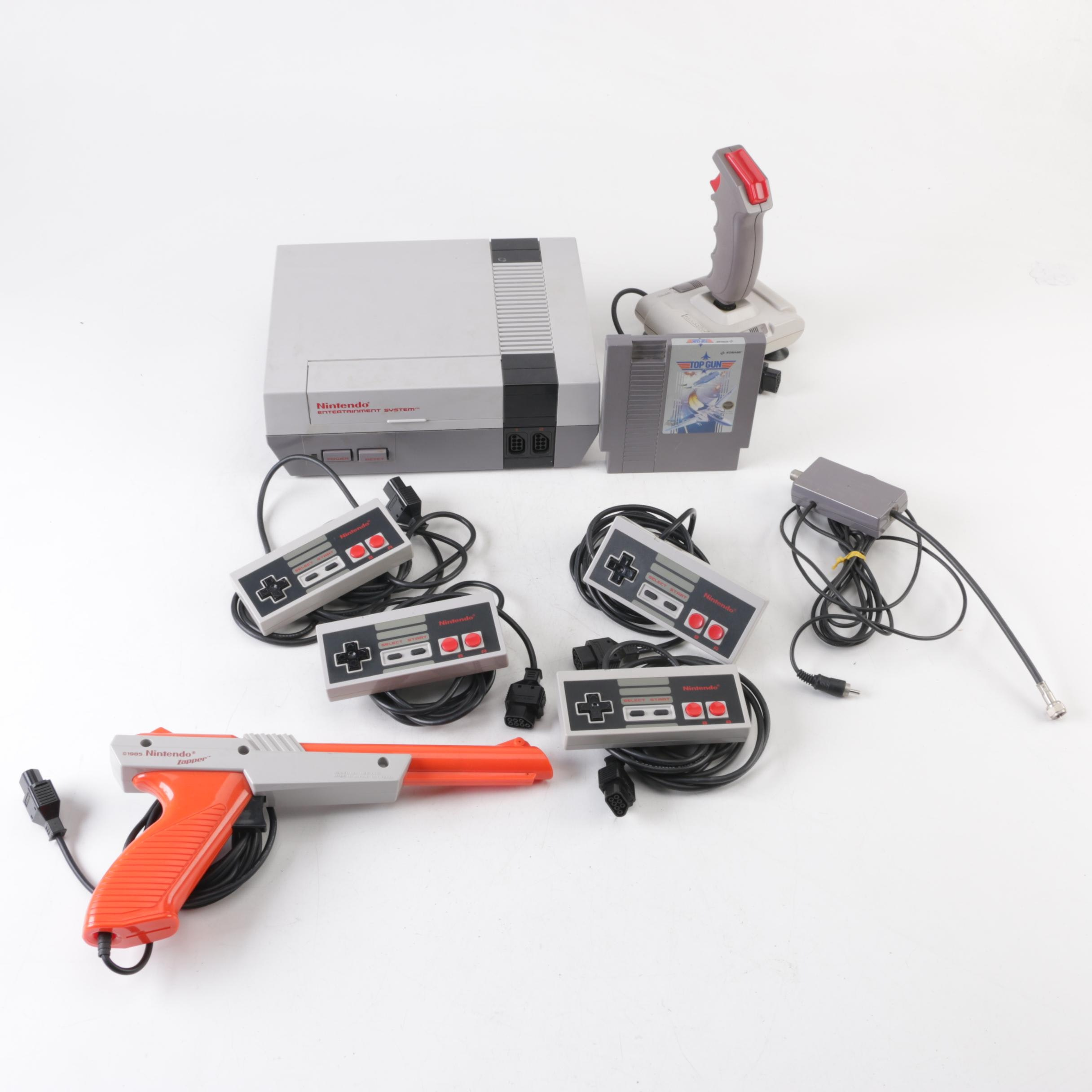 """Nintendo Entertainment System with Accessories and """"Top Gun"""" Game"""