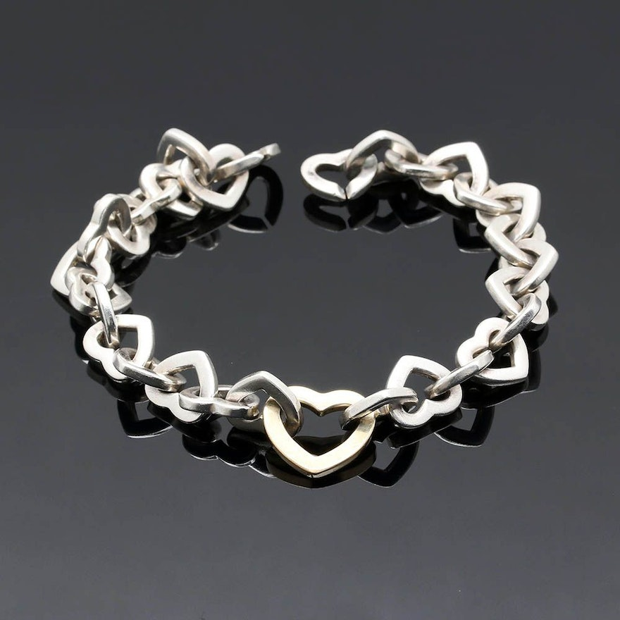 9e5424eea6f Tiffany & Co. Sterling Silver and 18K Yellow Gold Heart Link Bracelet ...