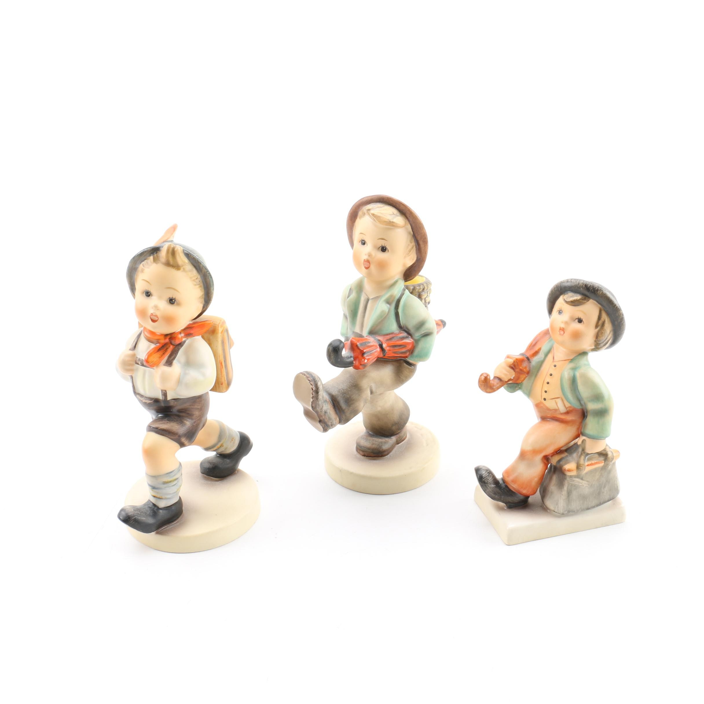 "Hummel ""Merry Wanderer,"" ""Globe Trotter,"" and ""School Boy"" Porcelain Figurines"
