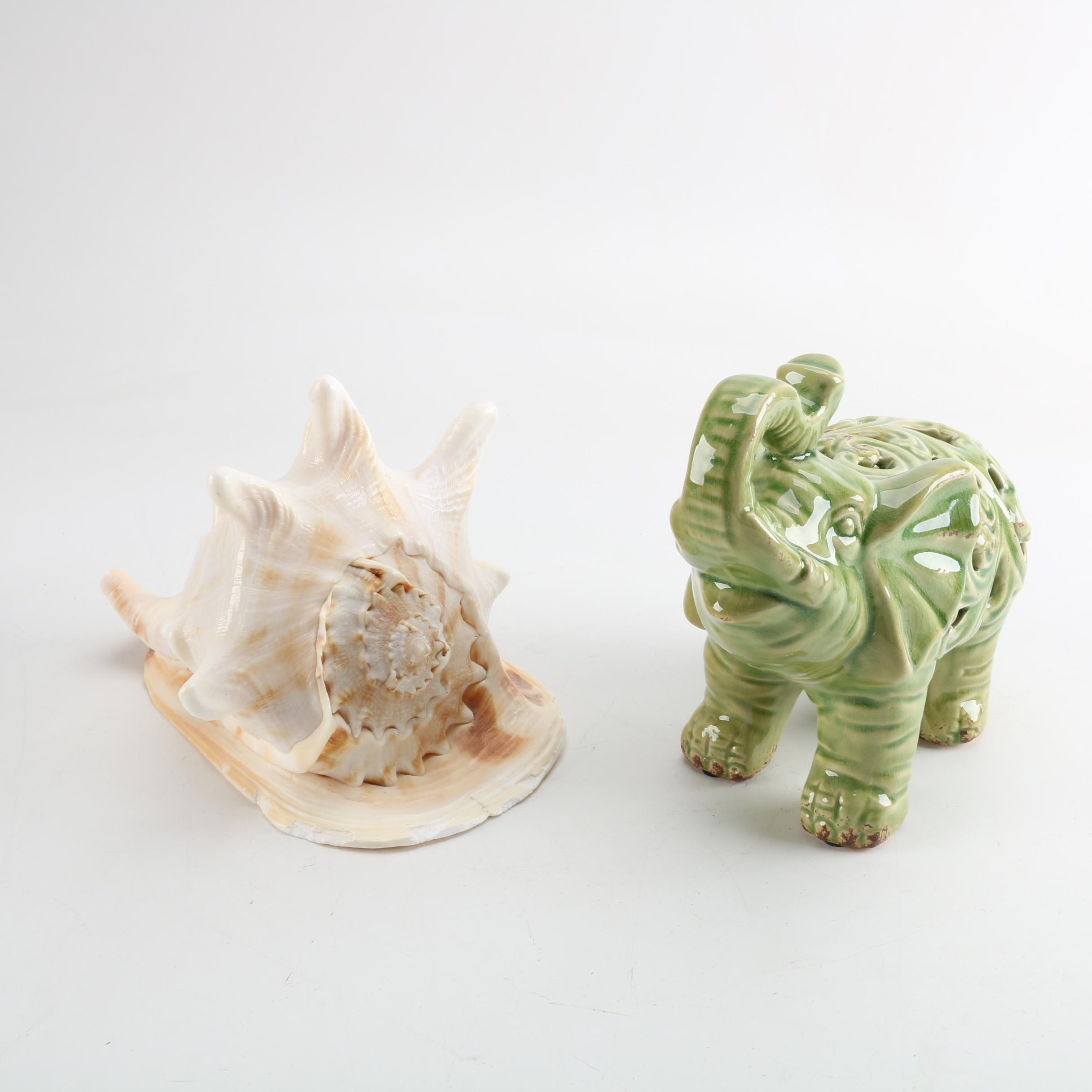 Ceramic Elephant Figurine and Queen Conch Shell