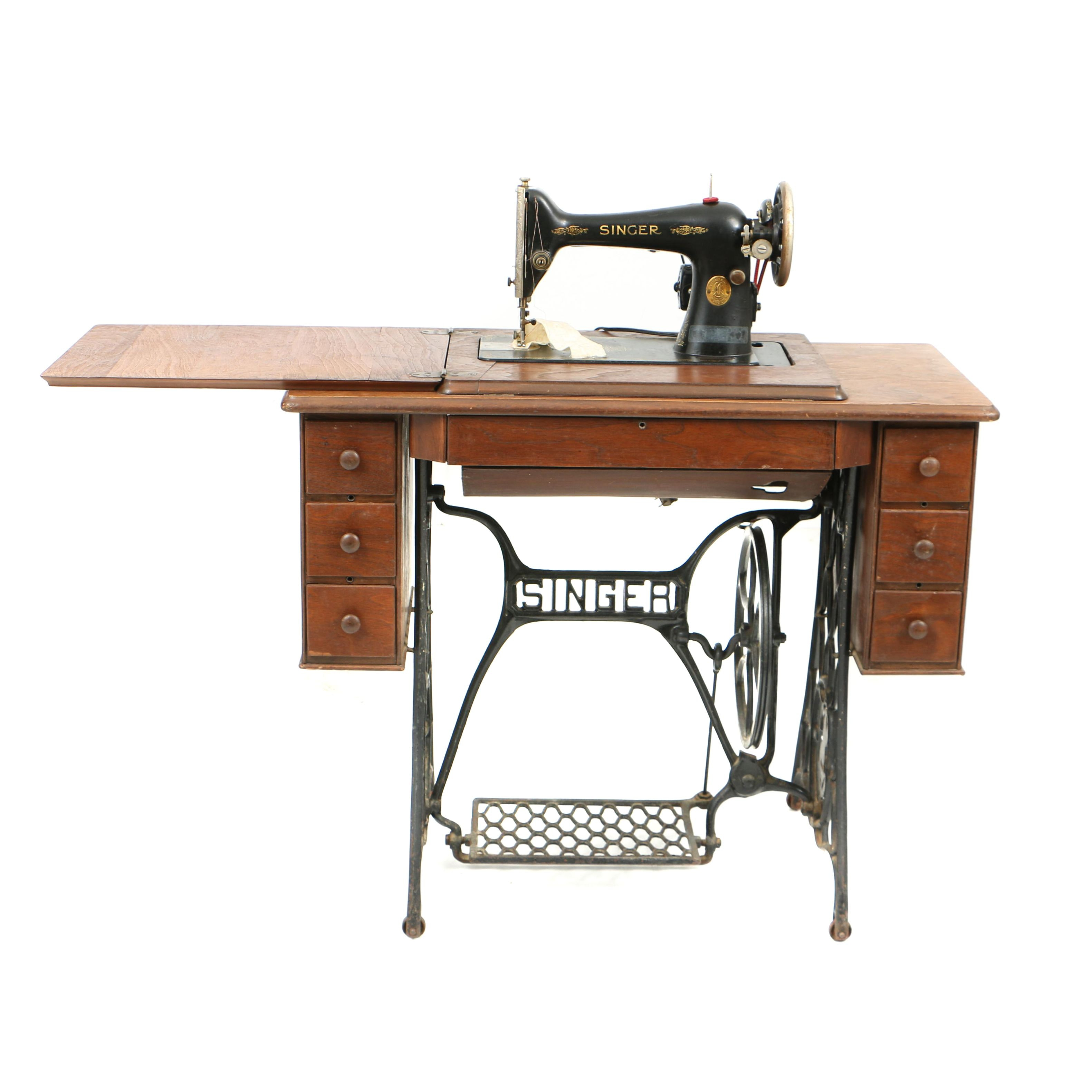 Early 20th Century Singer Sewing Machine with Treadle Table and Attachments