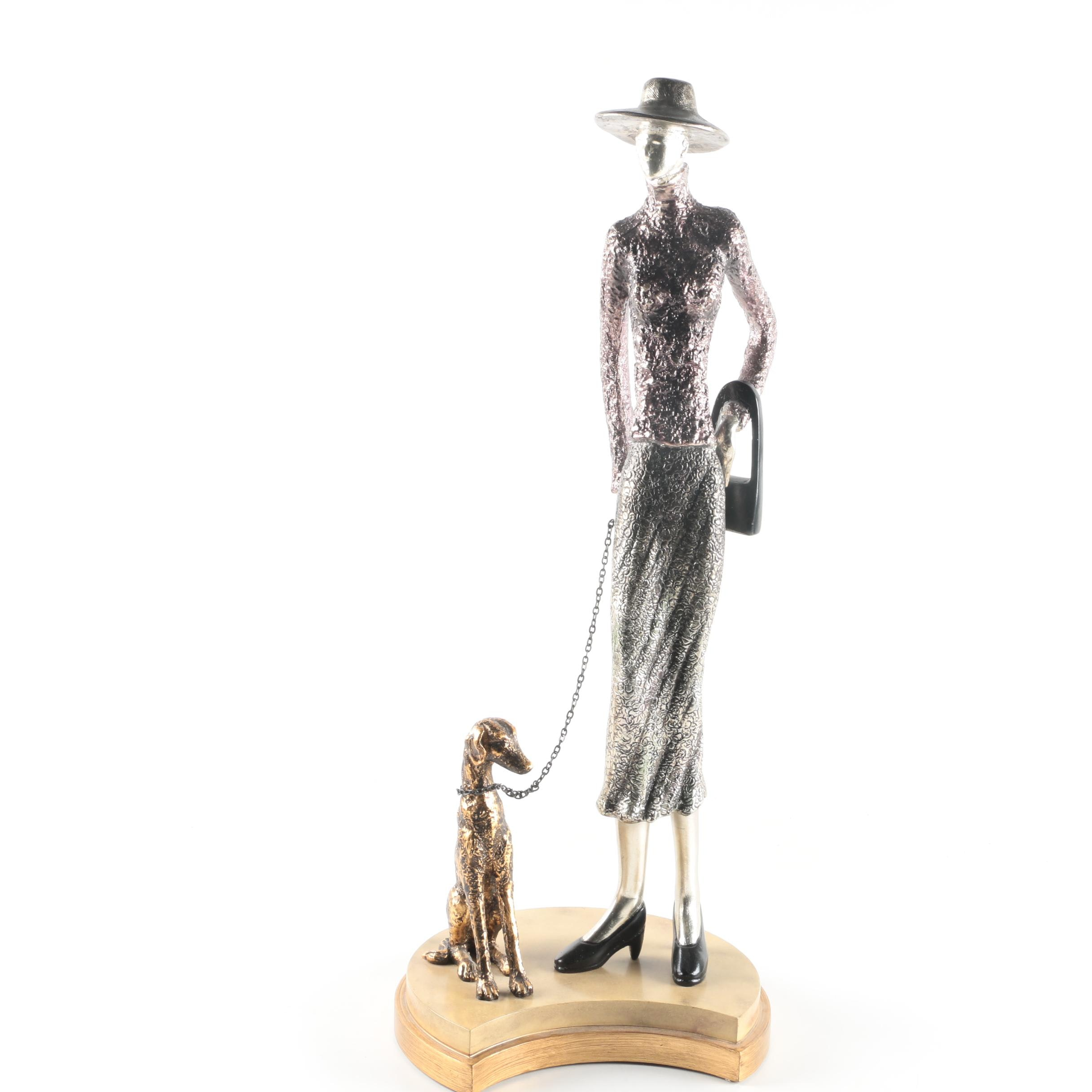 Metal Woman and Dog Figurine