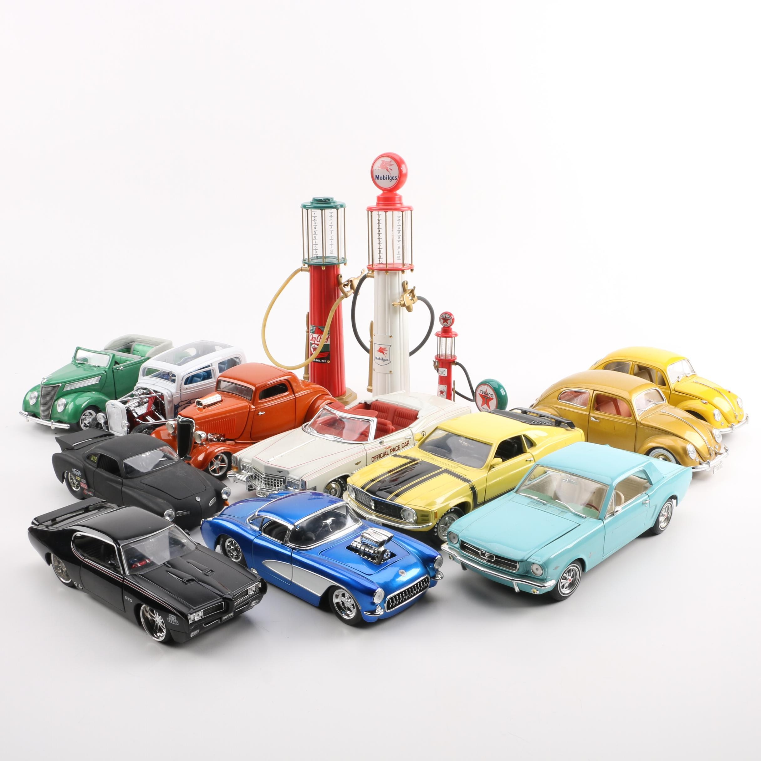 Die-Cast Cars and Gas Pumps
