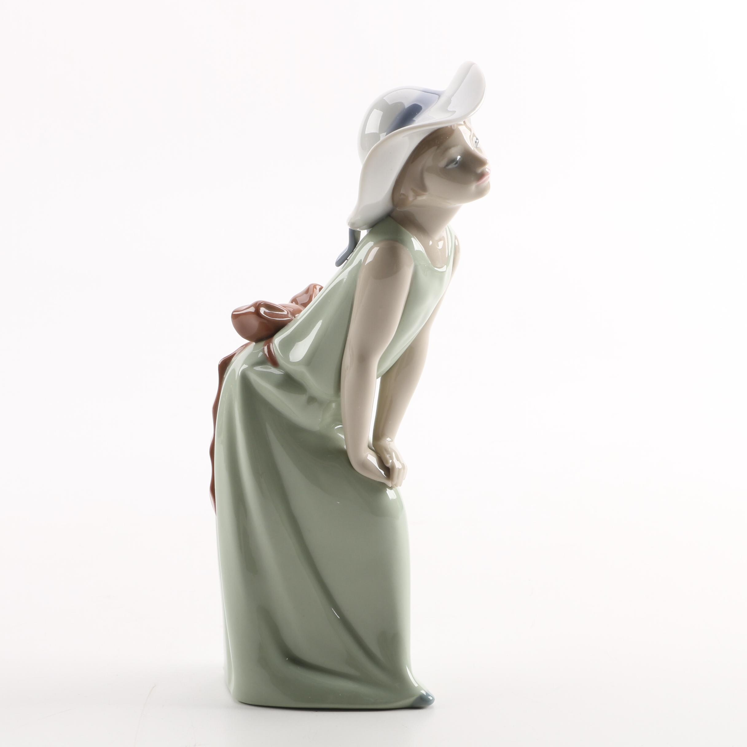 Lladro Leaning Girl in Hat Figurine