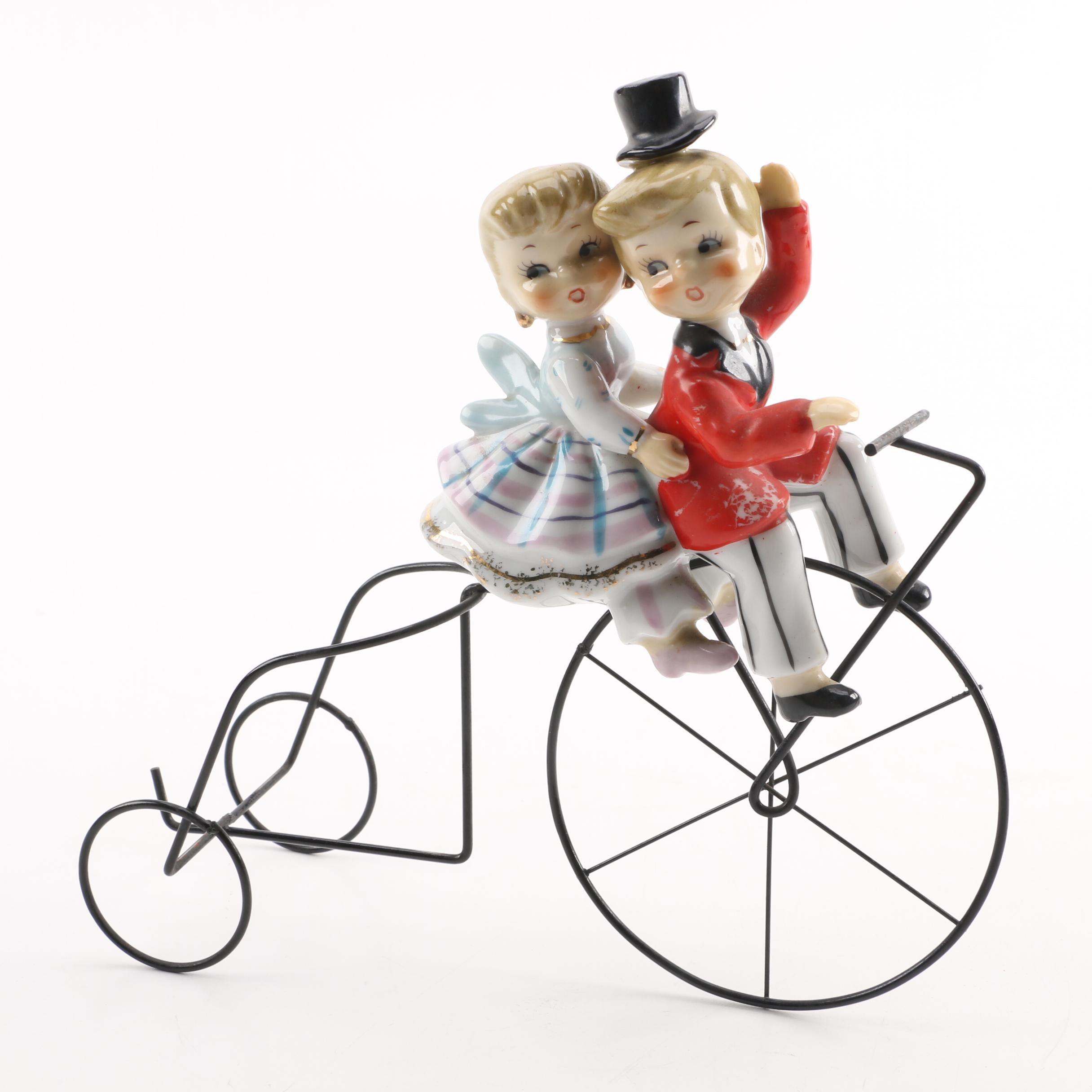 Boy and Girl Ceramic Figurines on Metal Bike