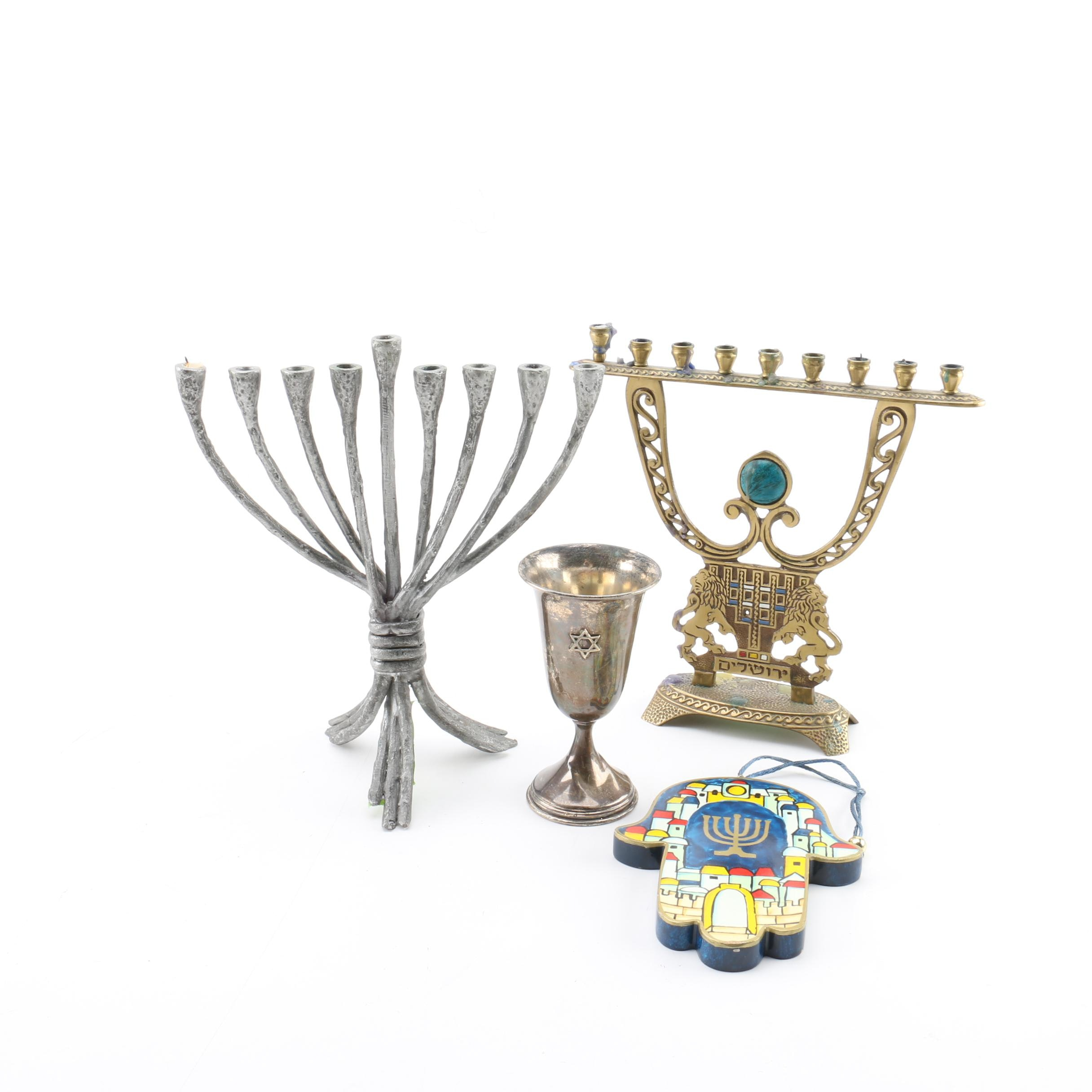 Collection of Judaica Décor including Esco Sterling Kiddush Cup and Menorahs