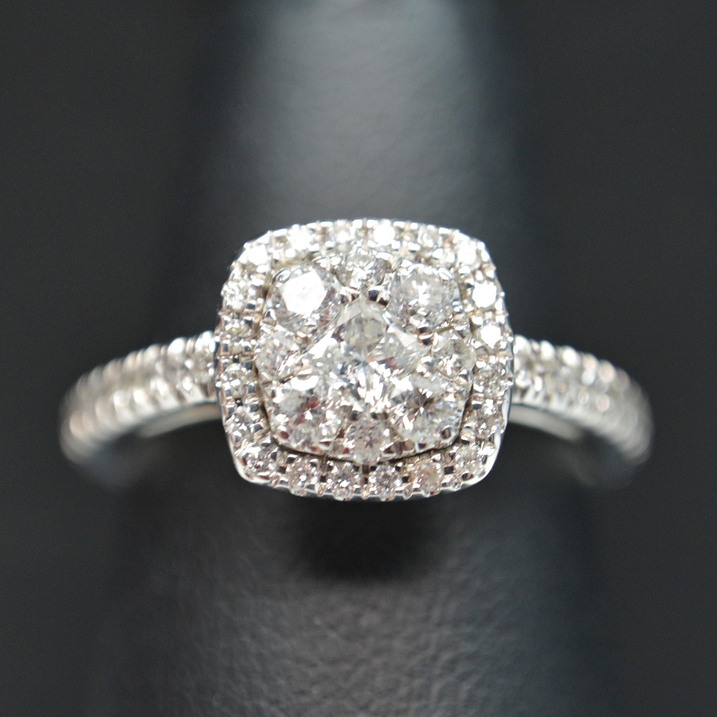 14K White Gold 0.75 CTW Diamond Halo Ring