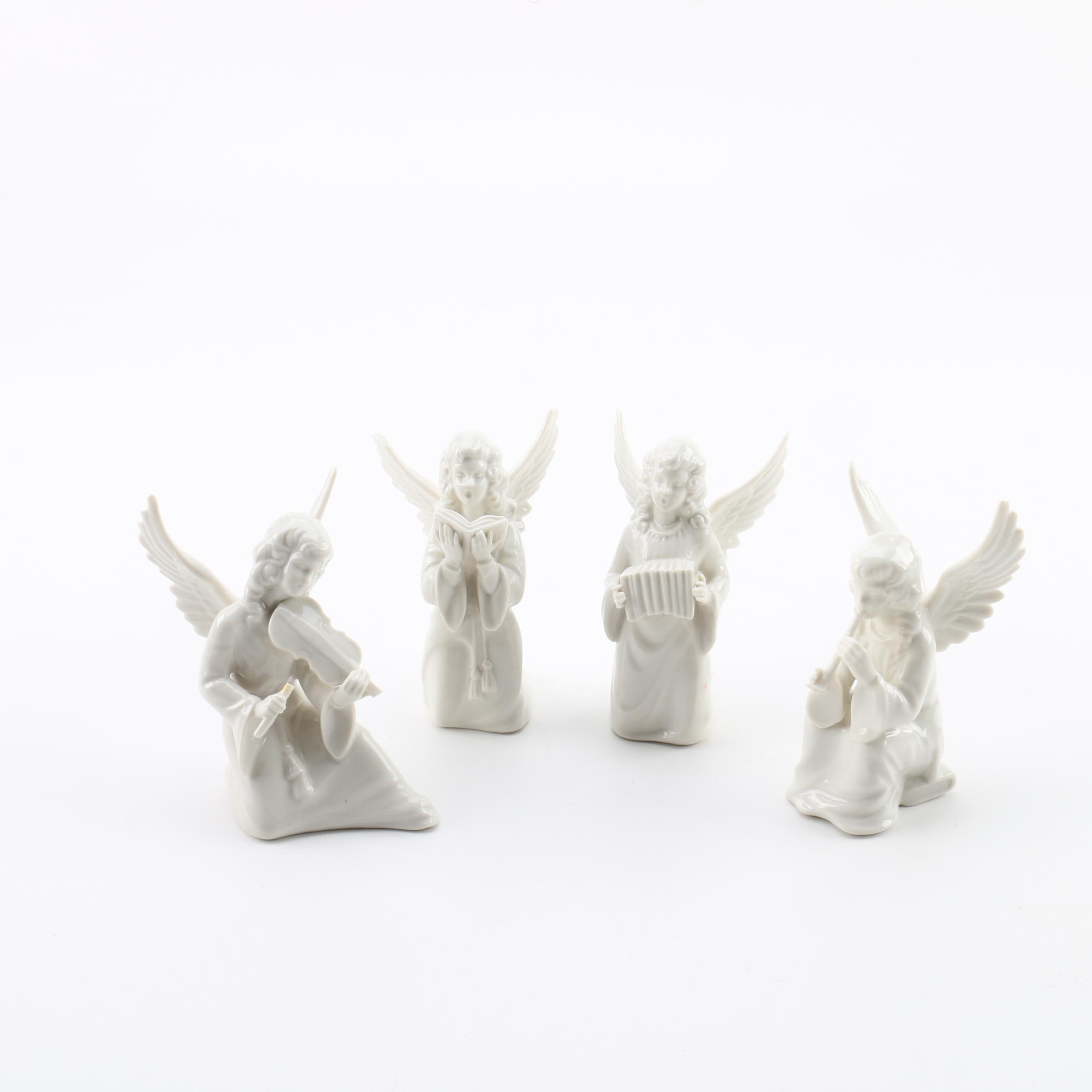 Four White Porcelain Dresden Style Angel Figurines