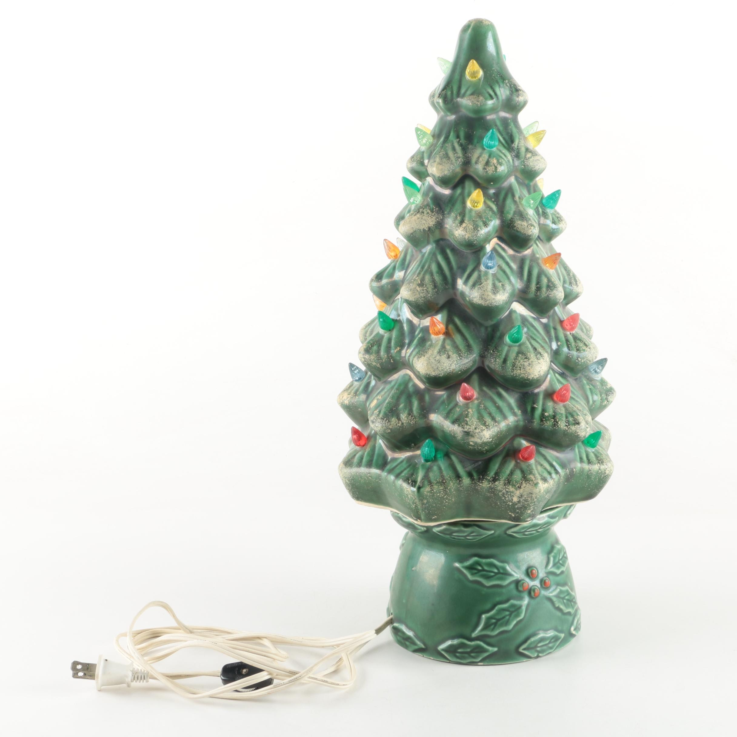 Green Ceramic Christmas Tree With Multicolor Lights and a Holly Base