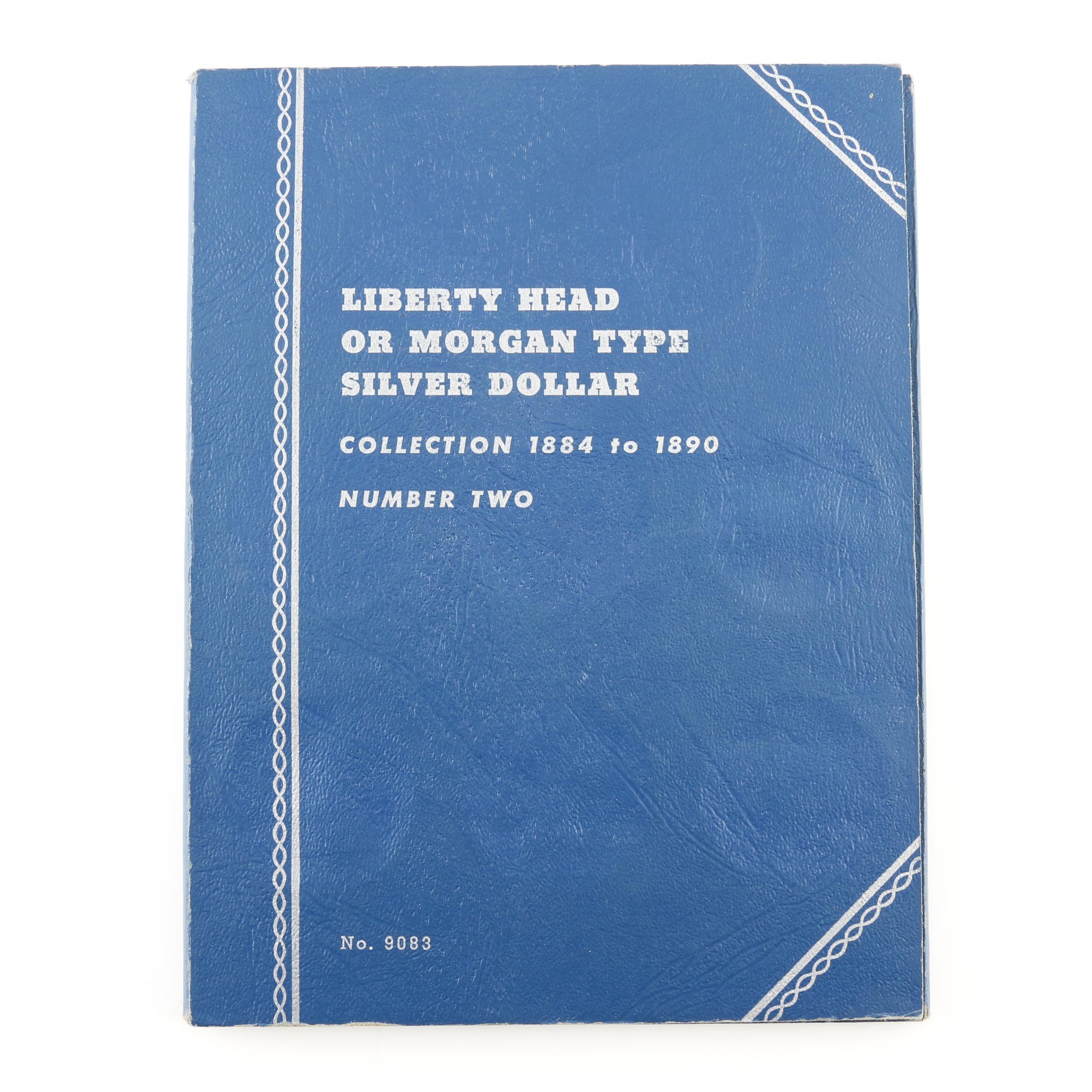 Group of 25 Silver Morgan Dollars in a Whitman Folder