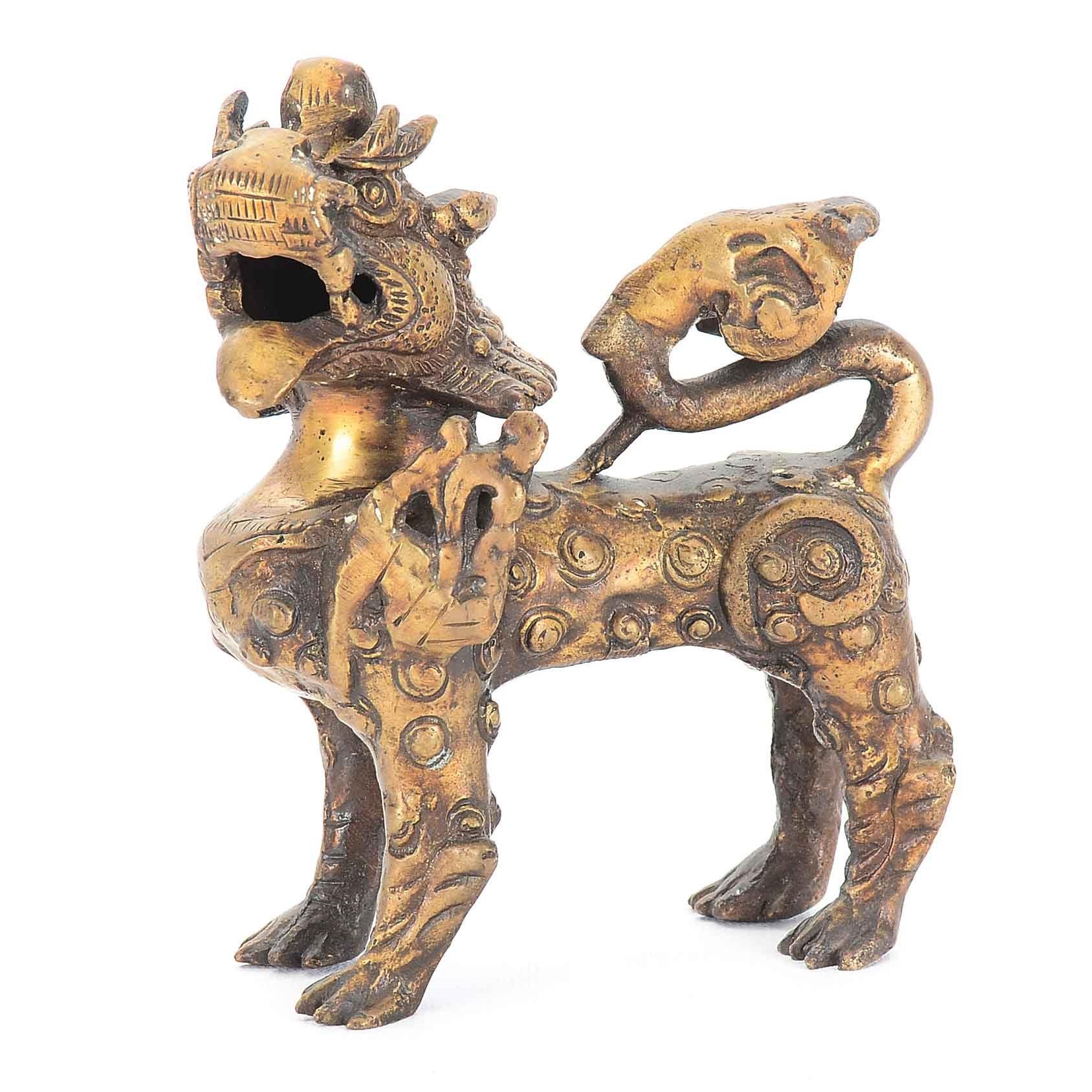 Vintage Sino-Tibetan Guardian Lion Figurine