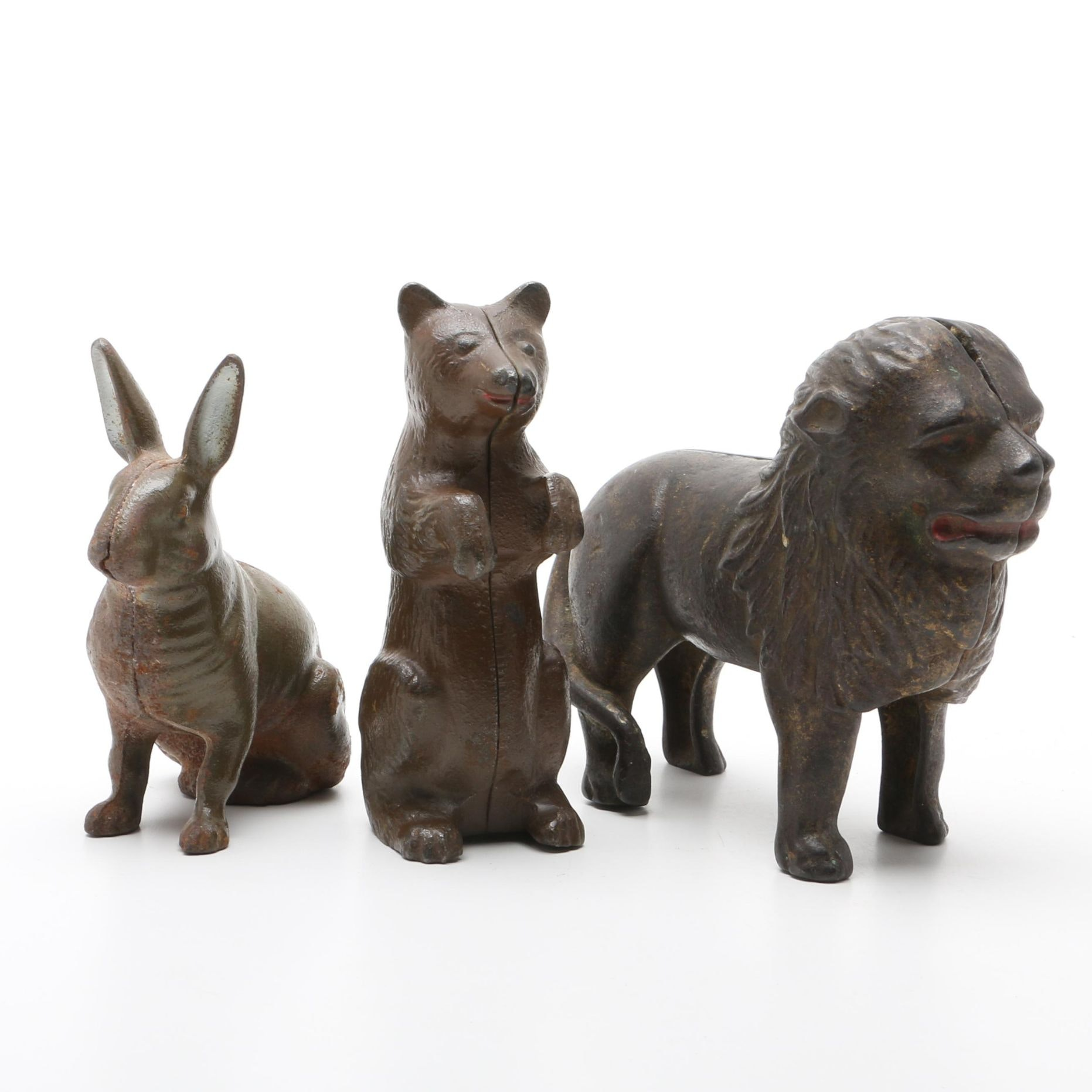 Vintage Cast Iron Banks of a Rabbit, a Bear, and a Lion