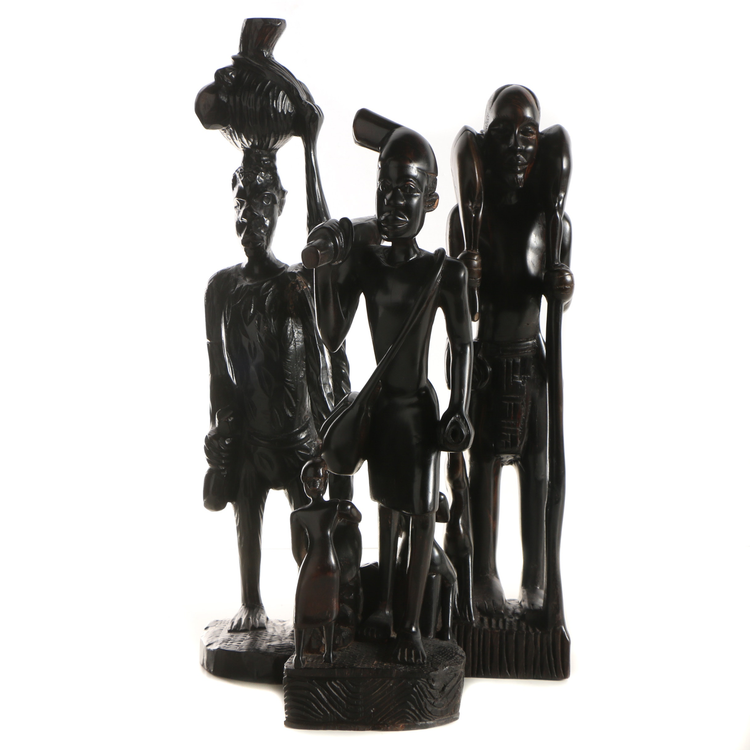 Three Carved Wooden Figurative Sculptures