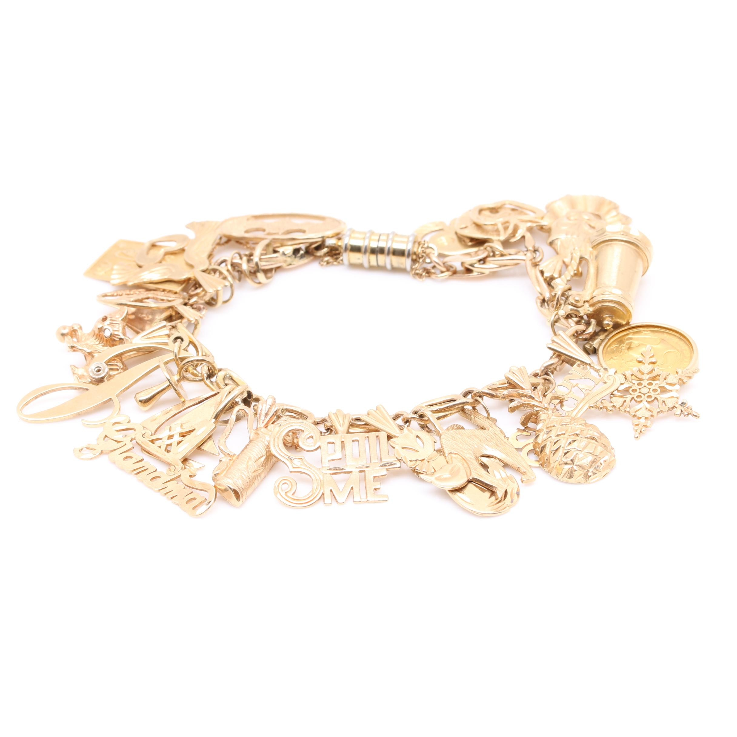 14K Yellow Gold Charm Bracelet with Twenty Five Charms
