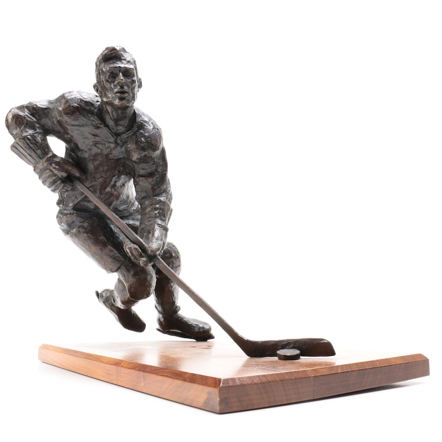 Bronze Sculpture of Hockey Player in Action, Signed