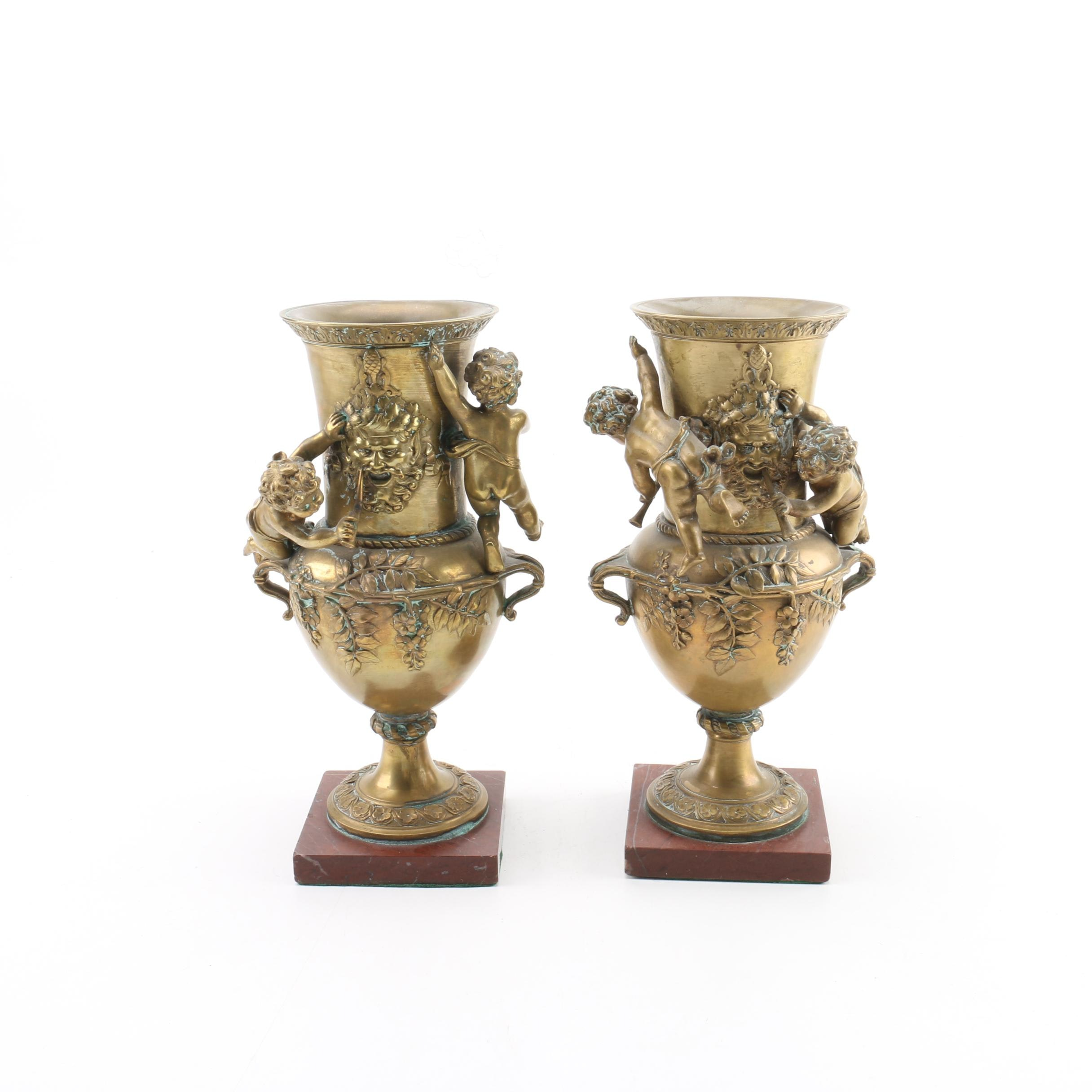 Neoclassical Style Brass Urns with Putti Motif on Rouge Marble Bases