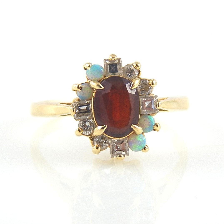 14K Yellow Gold Garnet, Opal, and Diamond Ring