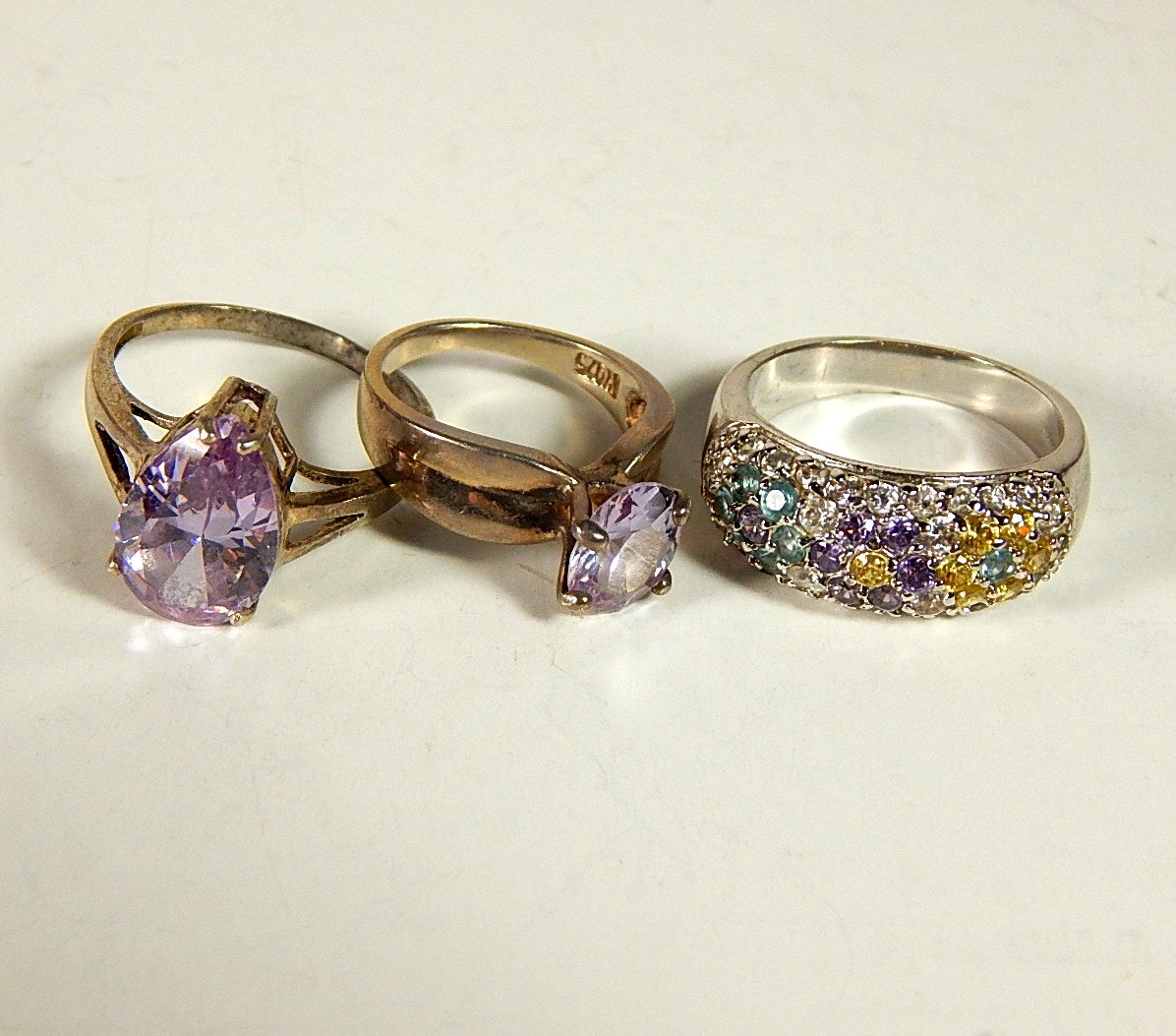 Three Sterling Silver Purple and Multi-Stone Rings