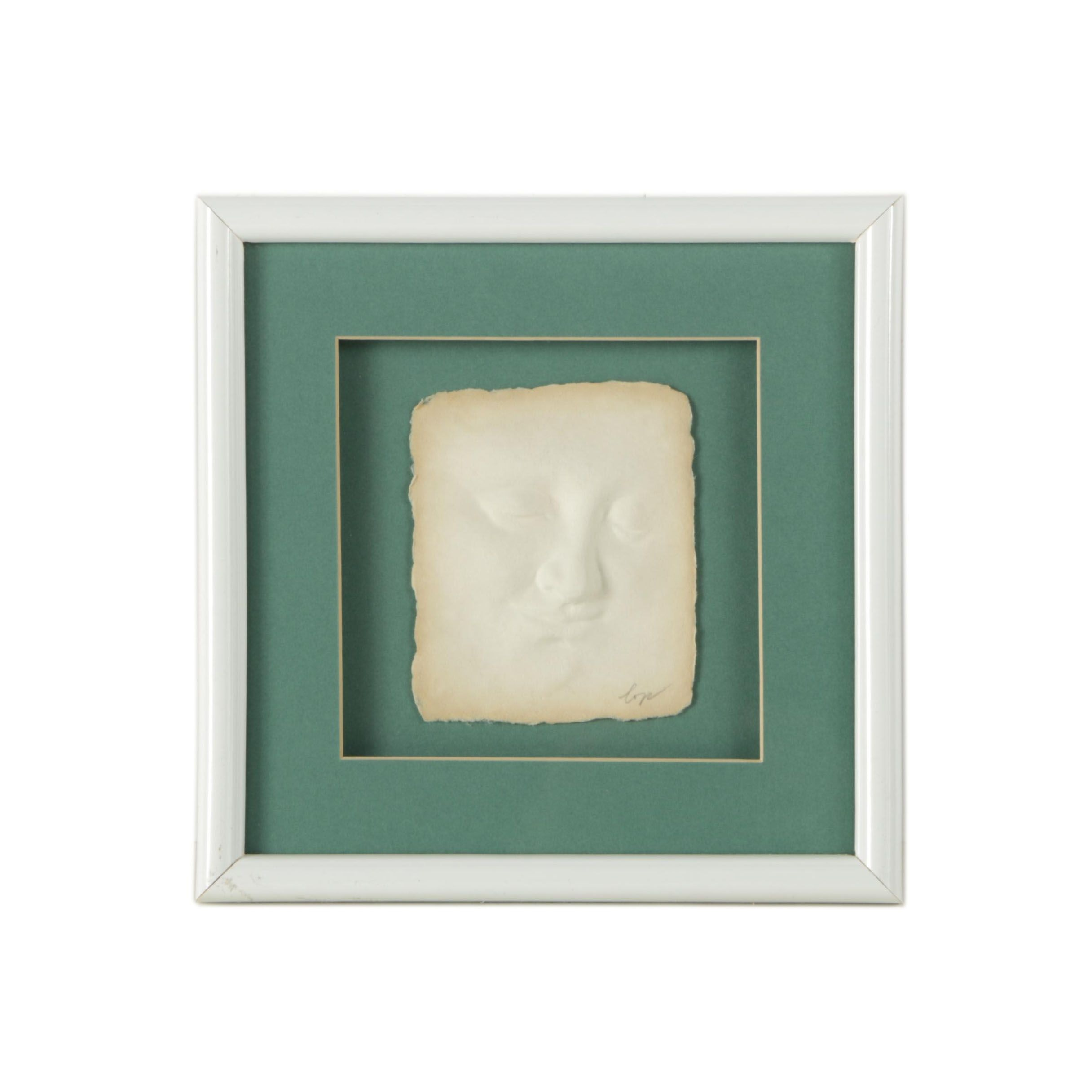 Paper Relief Sculpture of Smiling Face