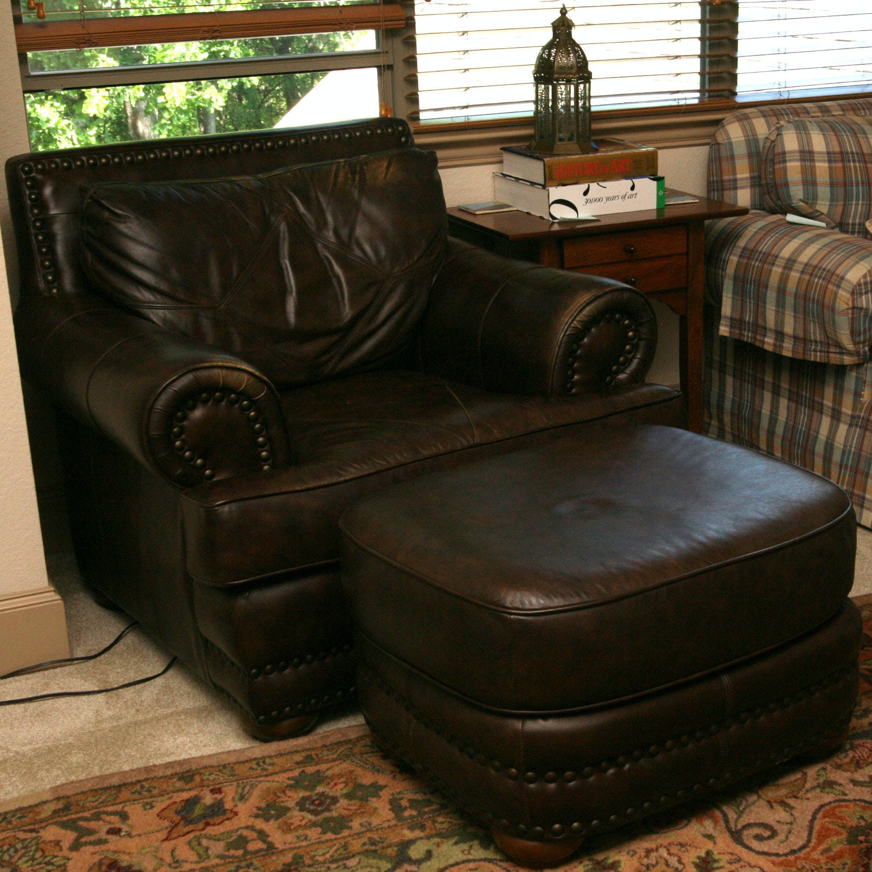 Brown Leather Armchair and Ottoman
