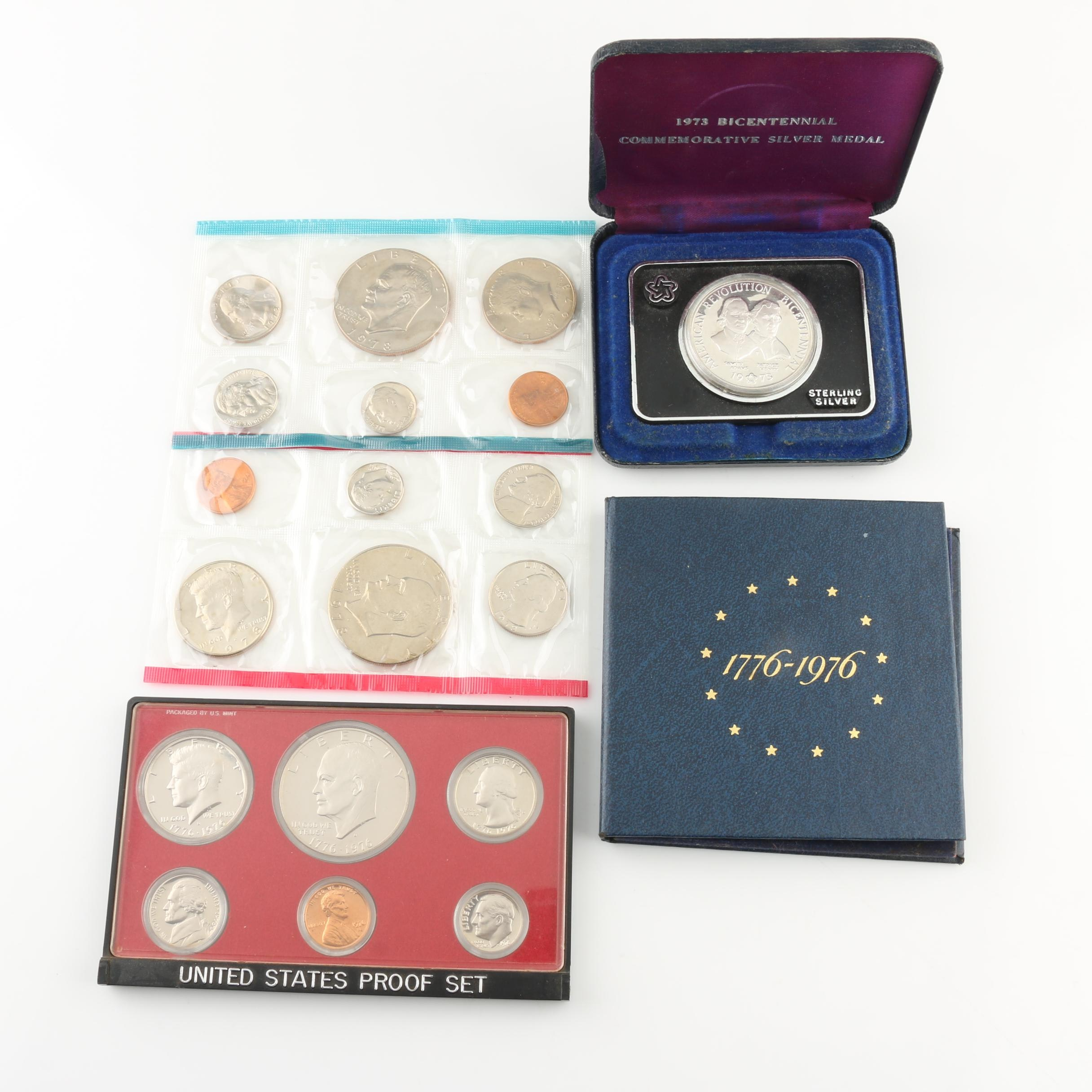 Three U.S. Mint Coin Sets and a Commemorative Bicentennial Silver Coin