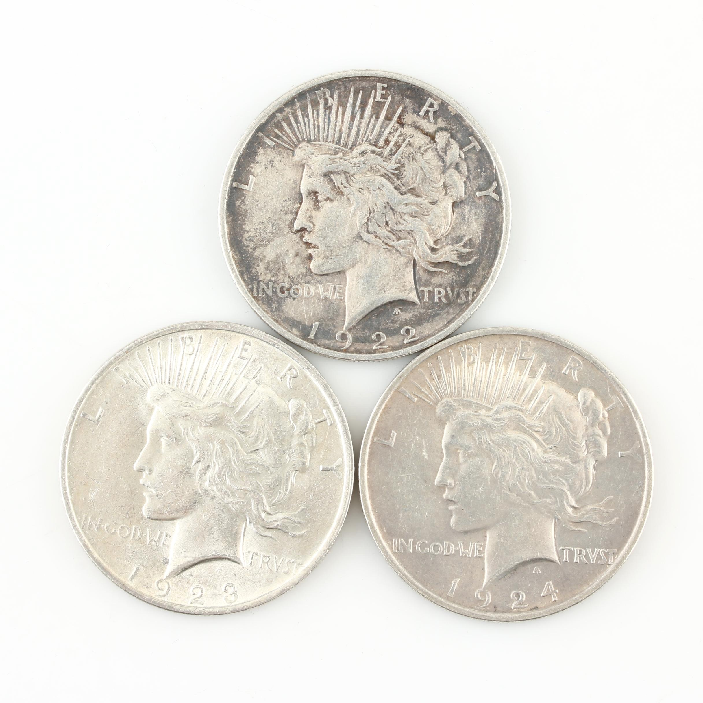 Group of Three Silver Peace Dollars: 1922-D, 1923, and 1924