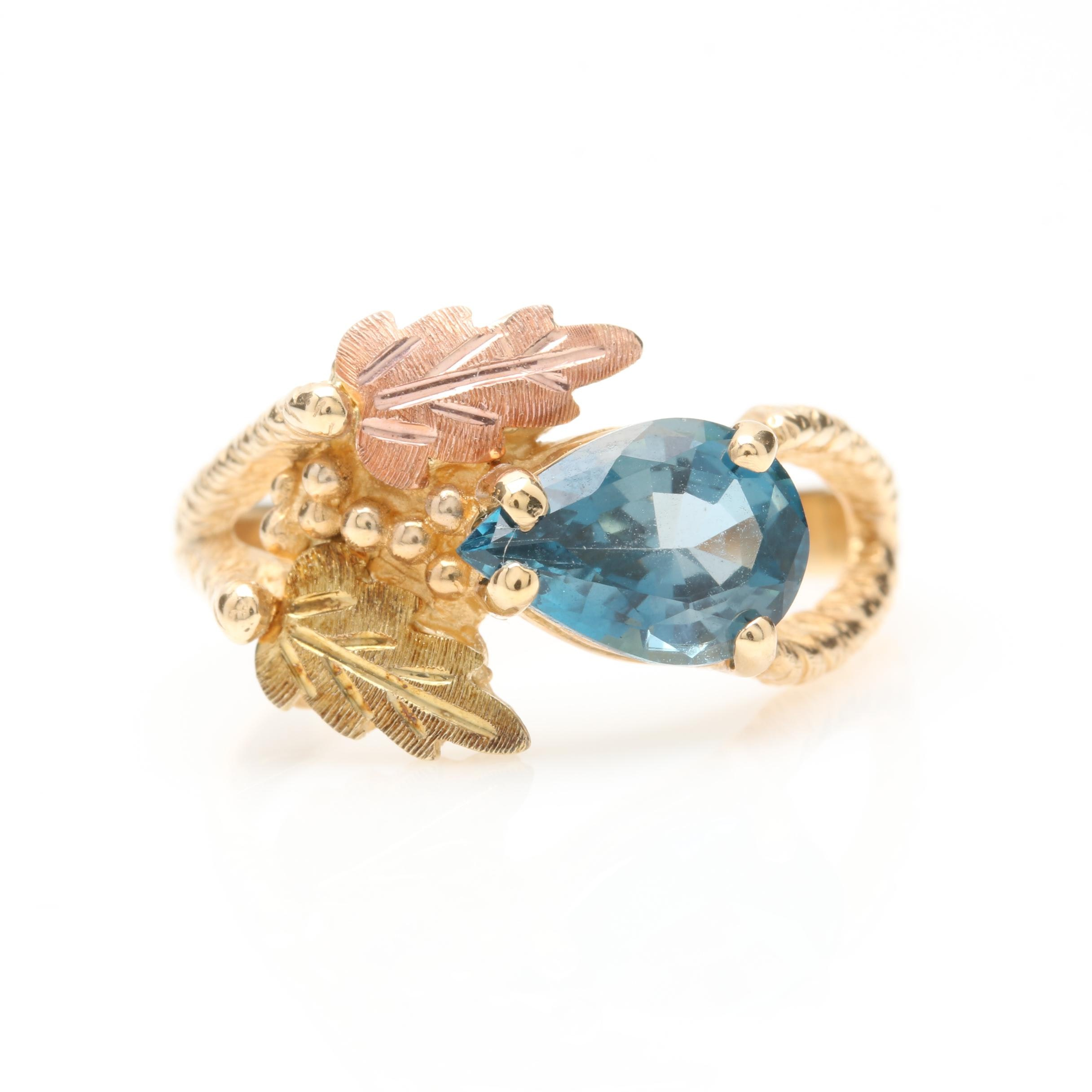 10K Yellow Gold 1.53 CT London Blue Topaz Ring With Rose and Green Gold Accents
