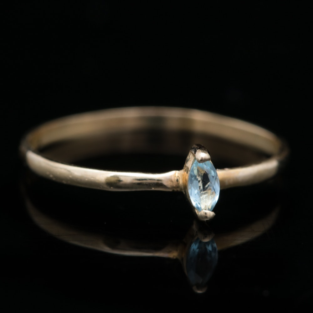 14K Yellow Gold and Marquise Blue Topaz Solitaire Ring