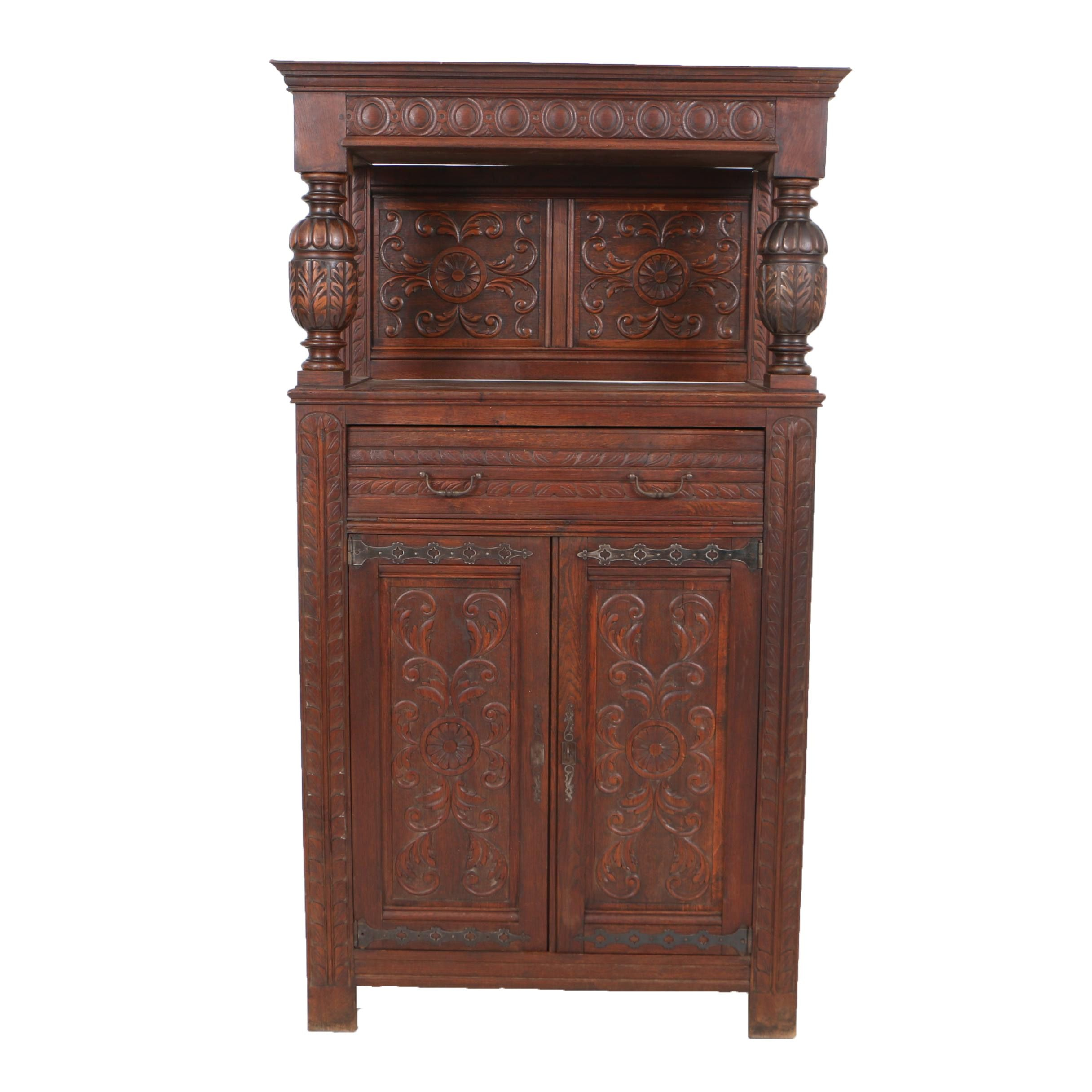 Early 20th Century Jacobean Style Carved Oak Fall-Front Bar Cabinet