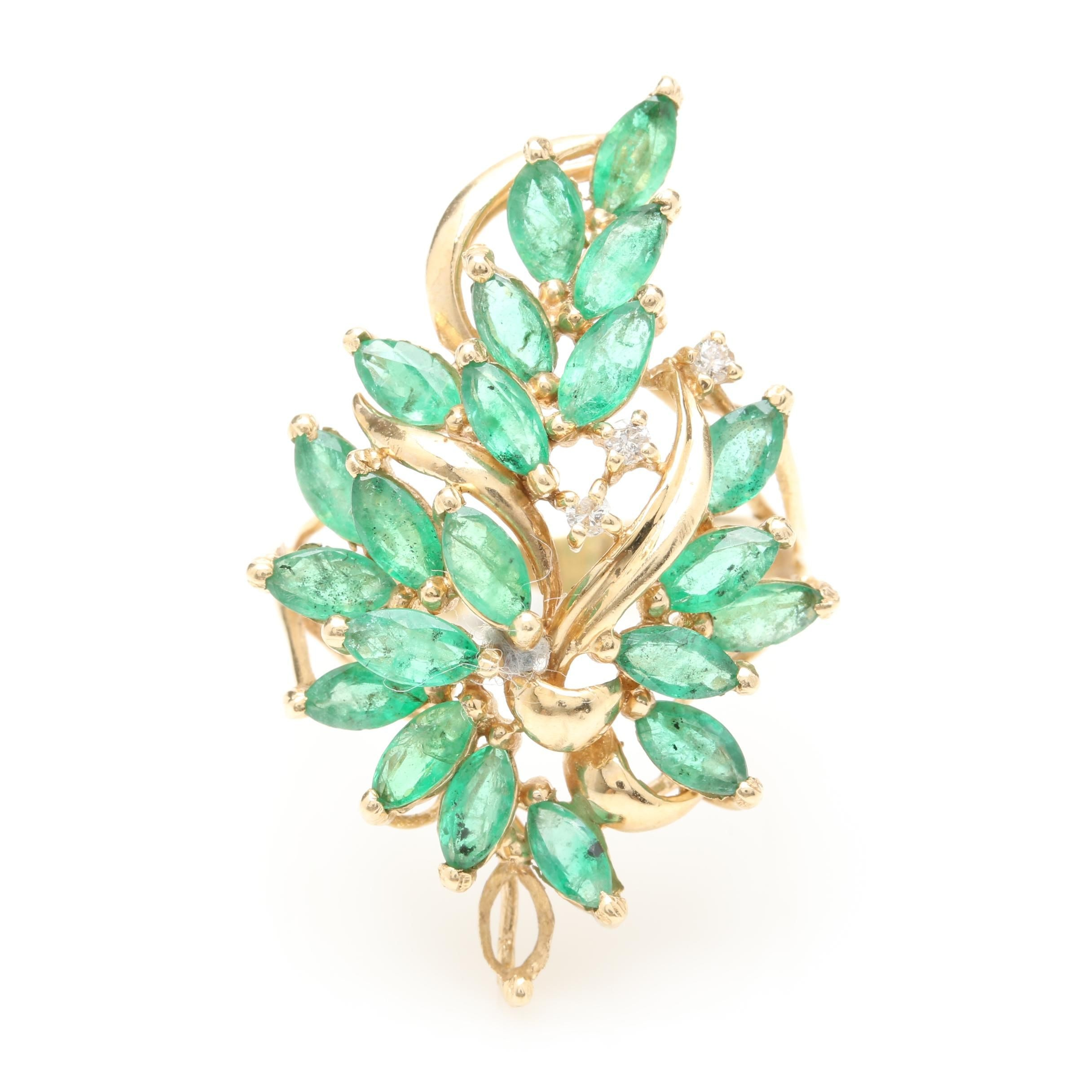 Circa 1950s - 1960s 14K Yellow Gold Emerald and Diamond Foliate Ring