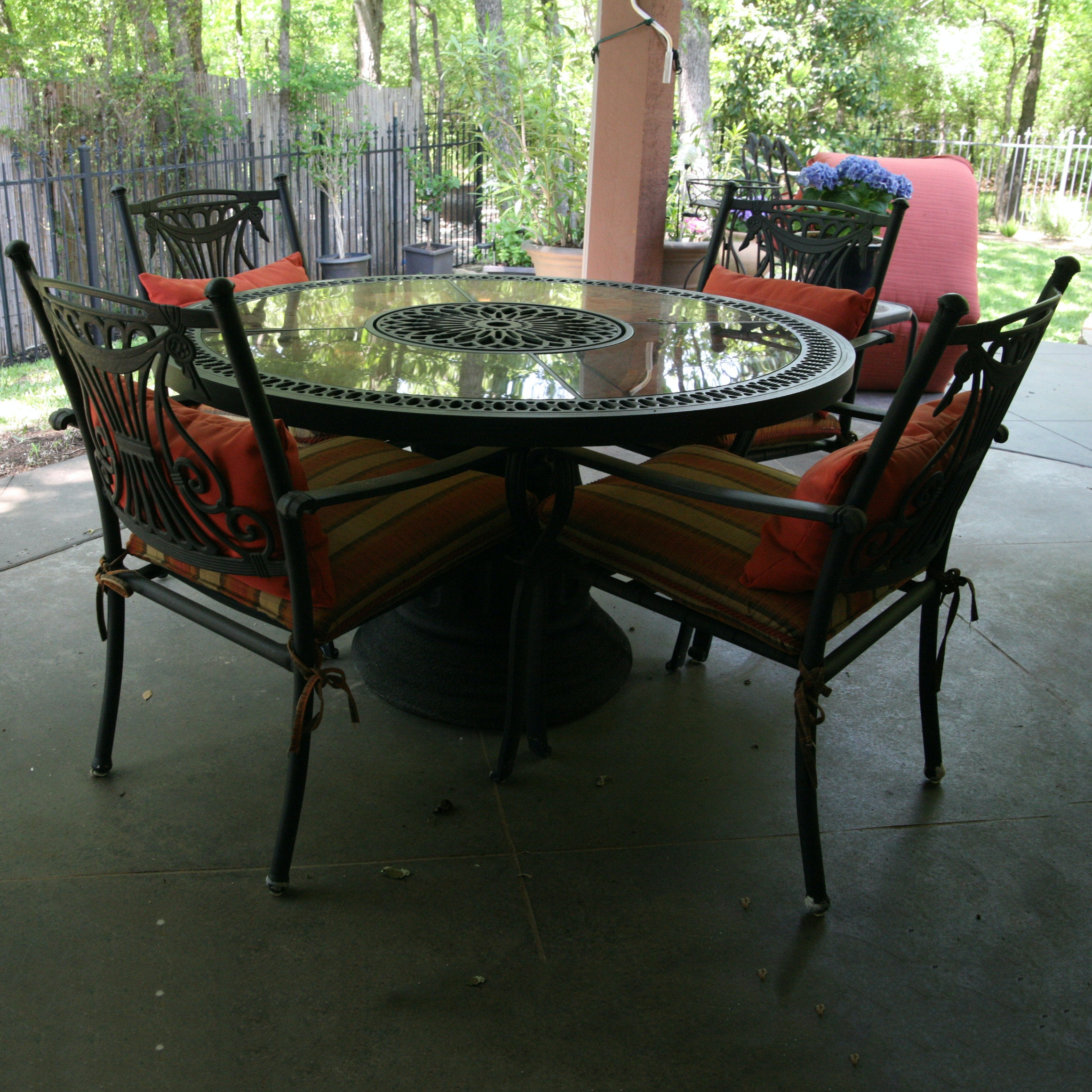Pierced Glass Top Metal Patio Table with Chairs and Cushions