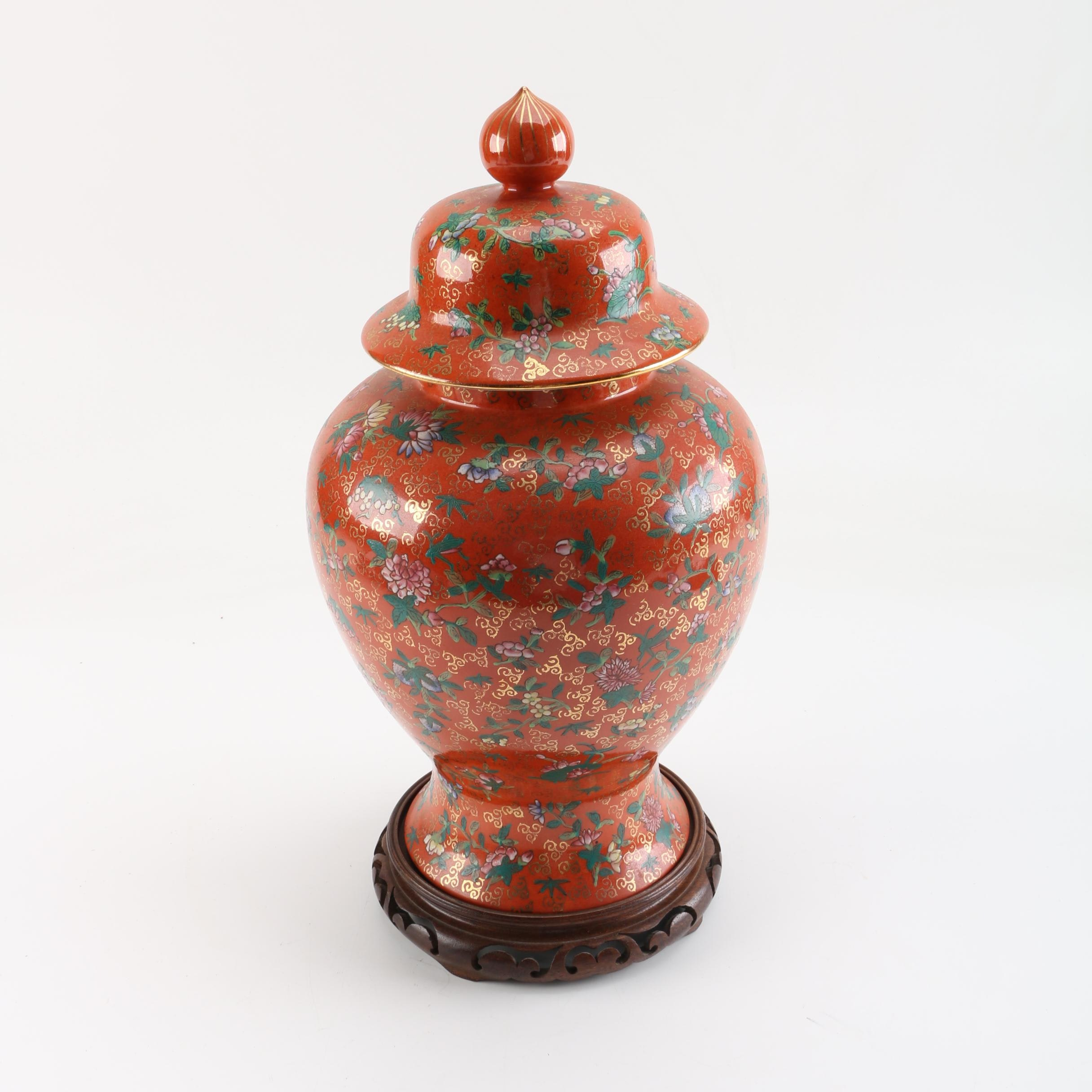 Chinese Ceramic Orange and Floral Urn with Wood Stand