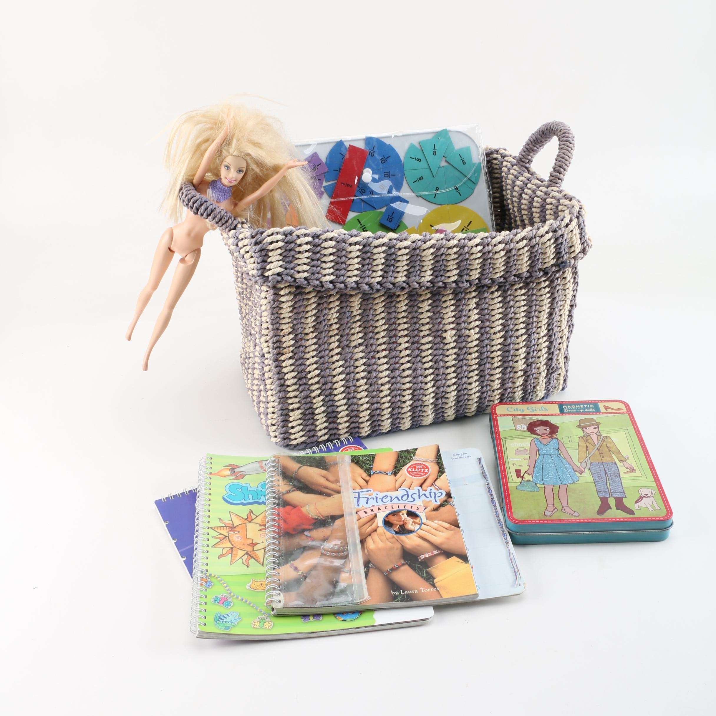 Woven Basket With Children's Crafts Books and a Doll