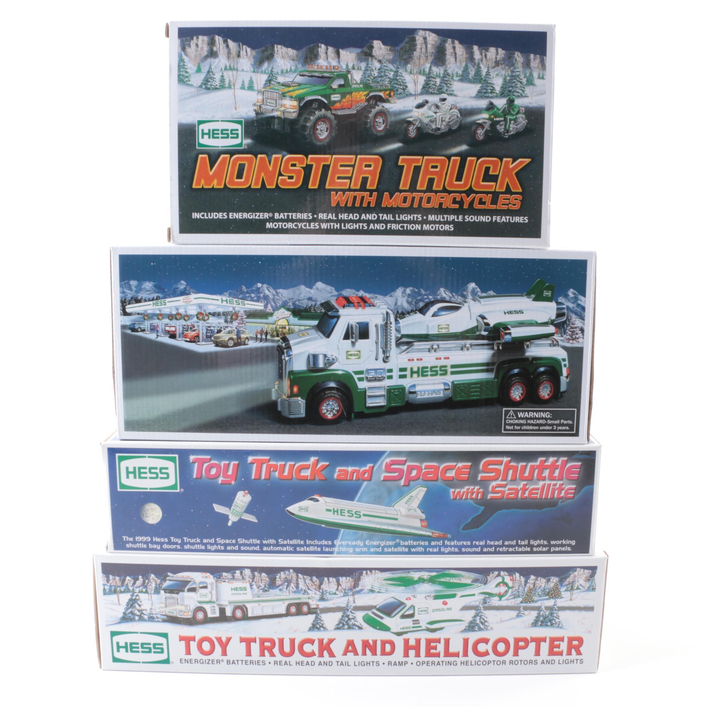 Four Hess Trucks