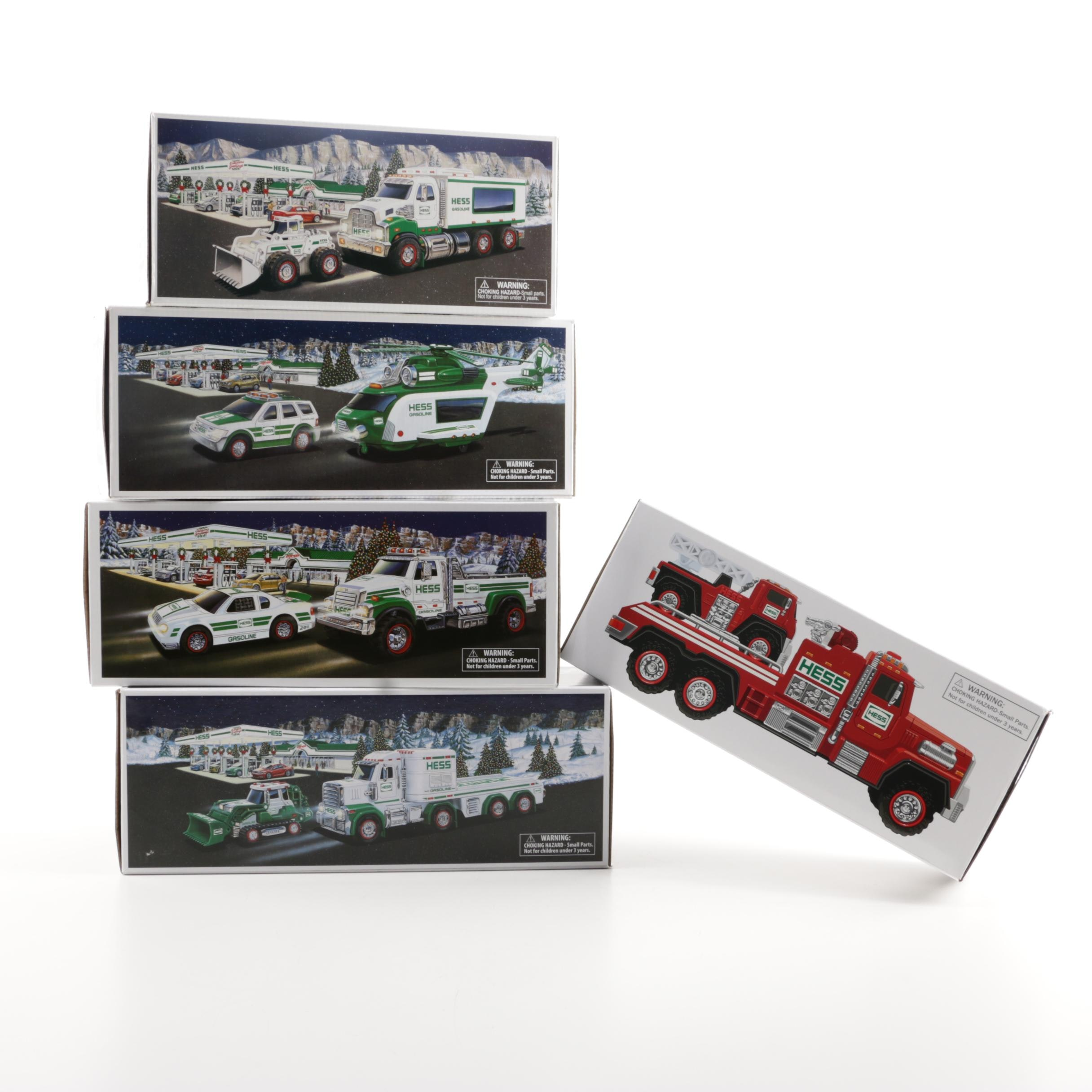 Five Hess Trucks