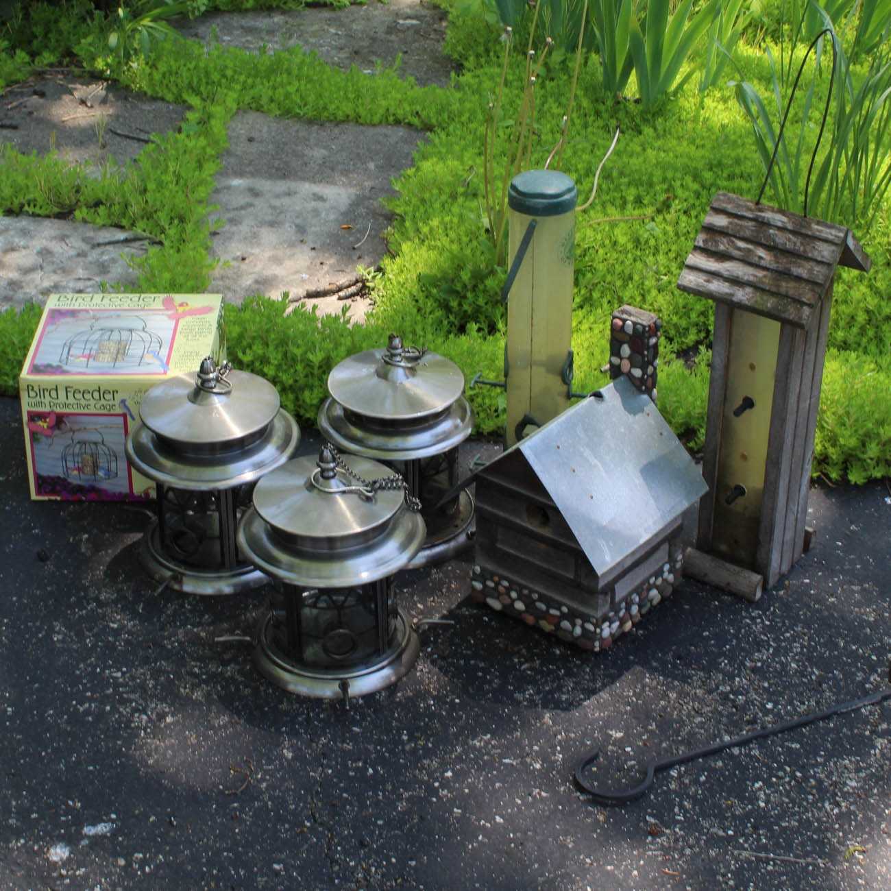 Assortment of Birdhouses and Feeders