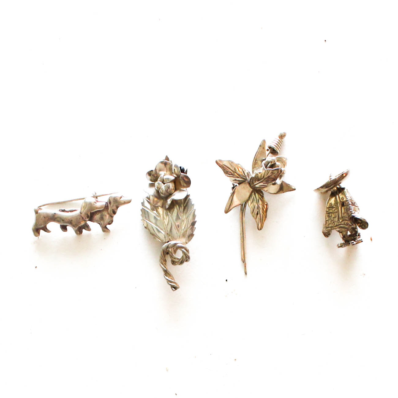 Selection of Sterling Silver Brooches Featuring Taxco