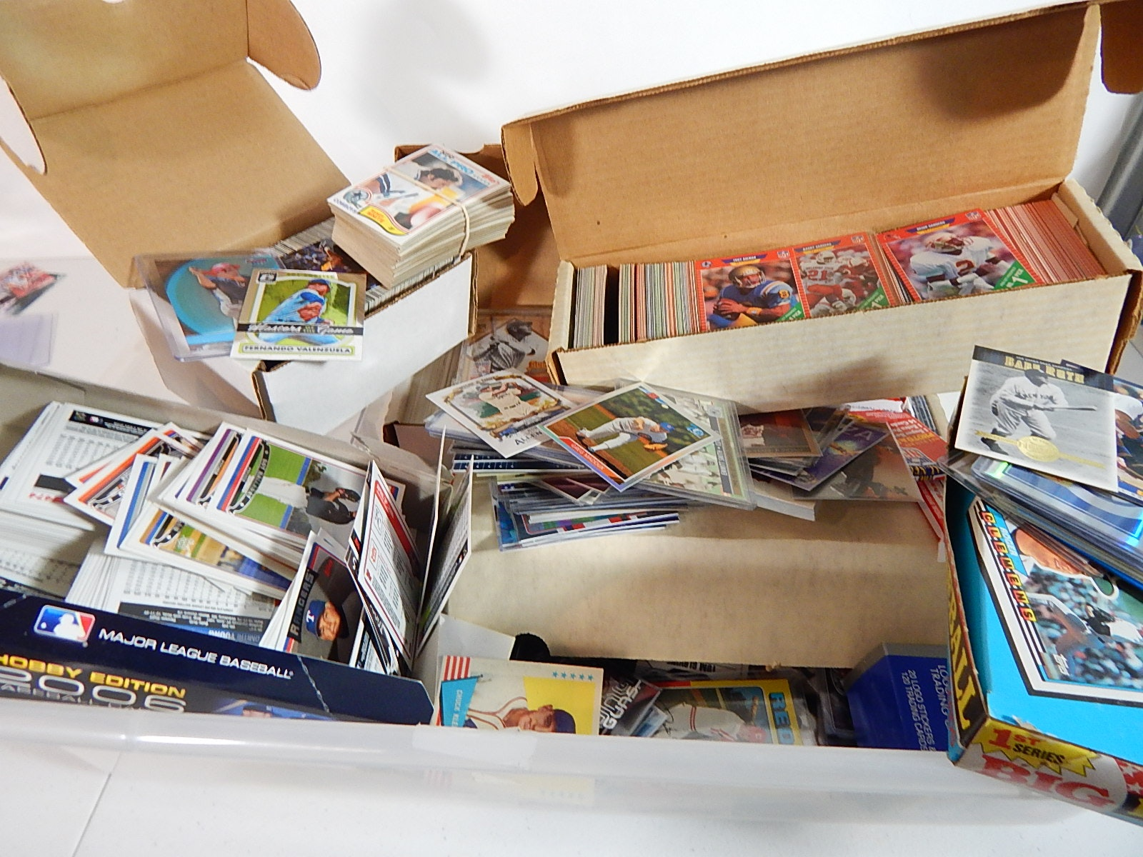 Tub of Sports Cards with Baseball, Basketball, Football, and Hockey