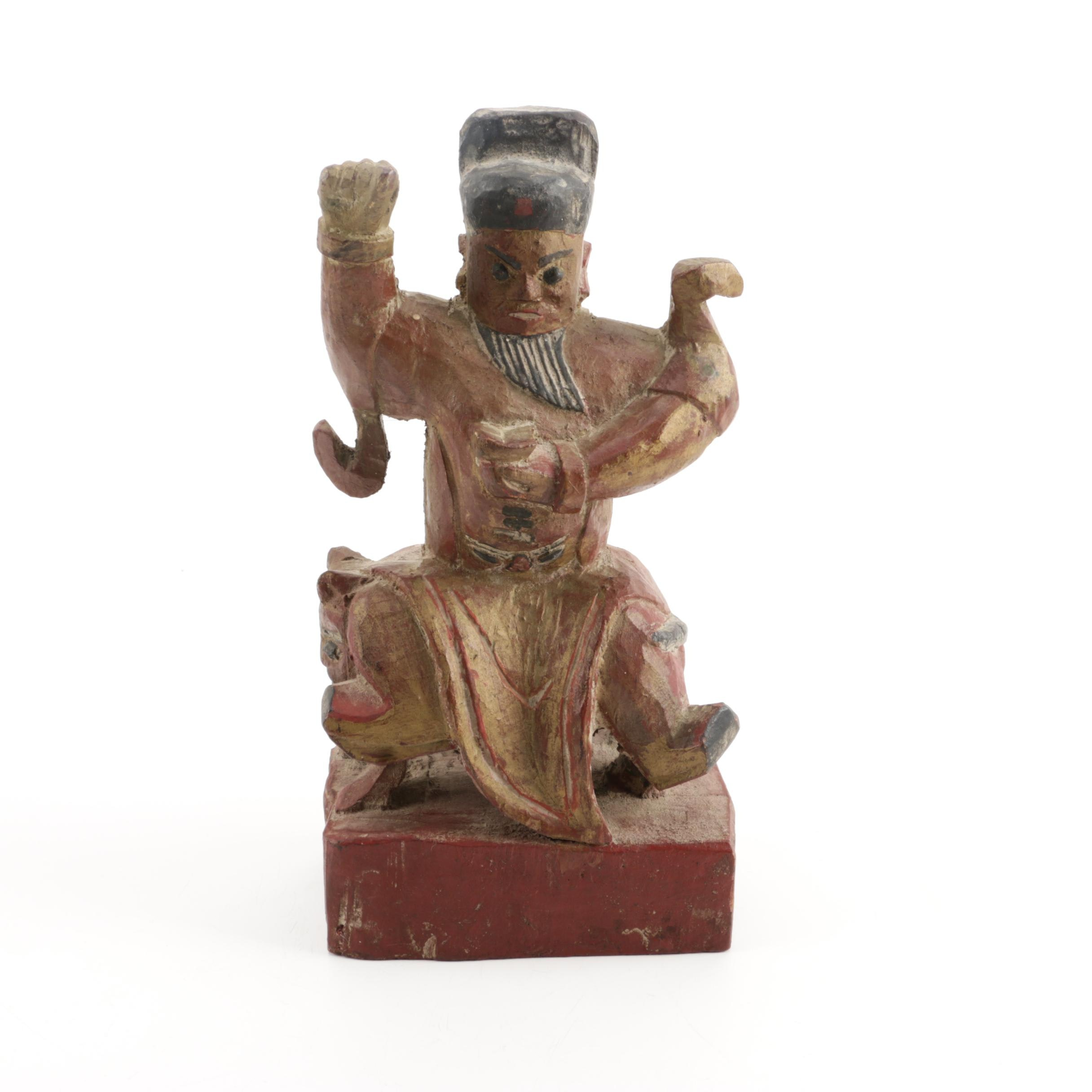 Wooden Figurine of Man Seated on Stylized Animal